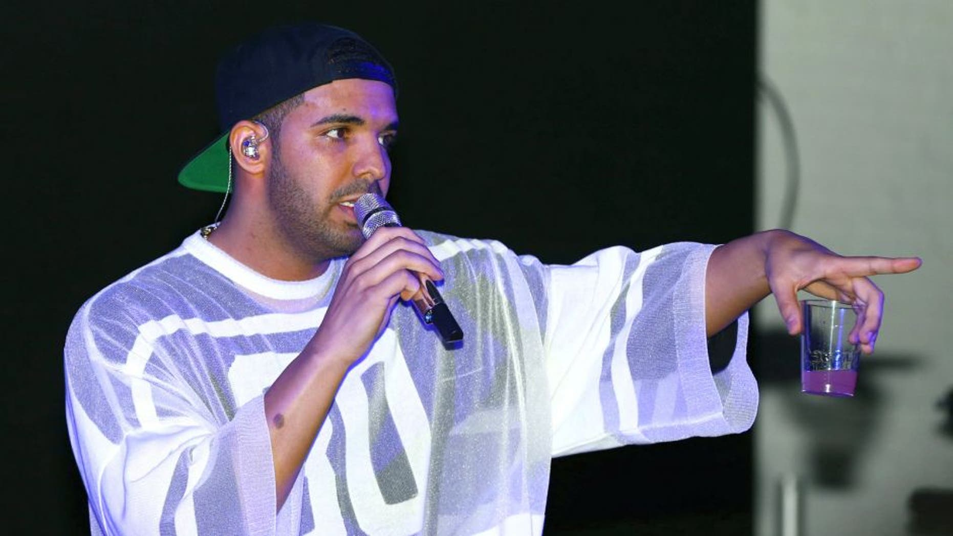 Feb 1, 2014; New York, NY, USA; Recording artist/rapper Drake performs during the Revolt Party at the Time Warner Cable Studios. Mandatory Credit: Mark J. Rebilas-USA TODAY Sports