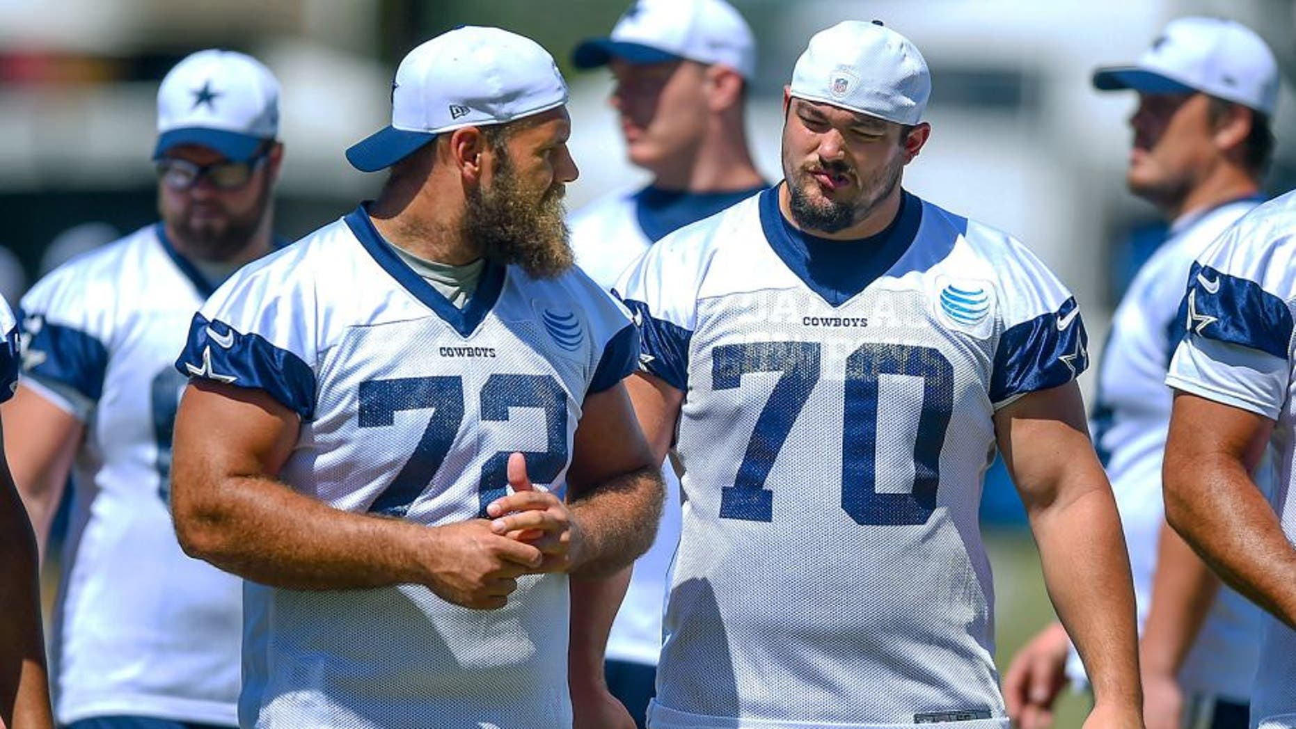 Dallas Cowboys center Travis Frederick (72) and guard Zack Martin (70) take the field for morning practice at NFL football training camp, Tuesday, Aug. 4, 2015, in Oxnard, Calif. (AP Photo/Gus Ruelas)