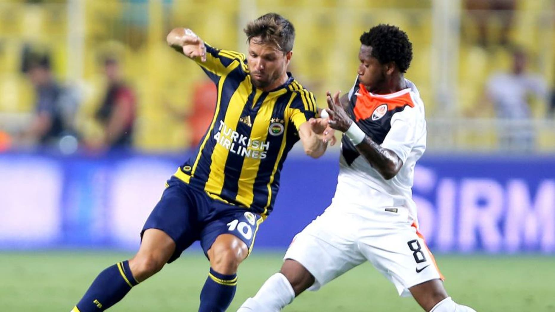 ISTANBUL, TURKEY - JULY 28: Fred of Shaktar Donetsk rides the ball past Fenerbahce's Souza during UEFA Champions League Third Qualifying Round 1st Leg match betweeen Fenerbahce v Shakhtar Donetsk at Sukru Saracoglu Stadium on July 28, 2015 in Istanbul, Turkey. (Photo by Burak Kara/Getty Images)