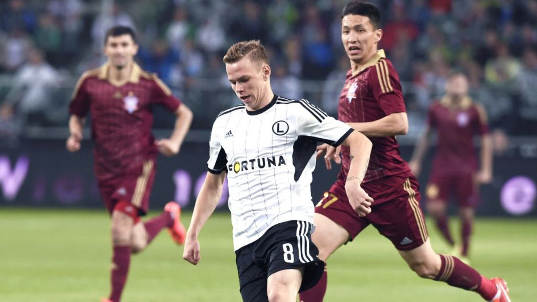 WARSAW, POLAND - AUGUST 28: (SOUTH AFRICA AND POLAND OUT) Ondrej Duda (C) of Legia during the UEFA Europa League qualifying play off round second leg match between Legia Warszawa and FK Aktobe at the Polish Army Stadium on August 28, 2014 in Warsaw, Poland. (Photo by Adam Jagielak/Gallo Images/Getty Images)