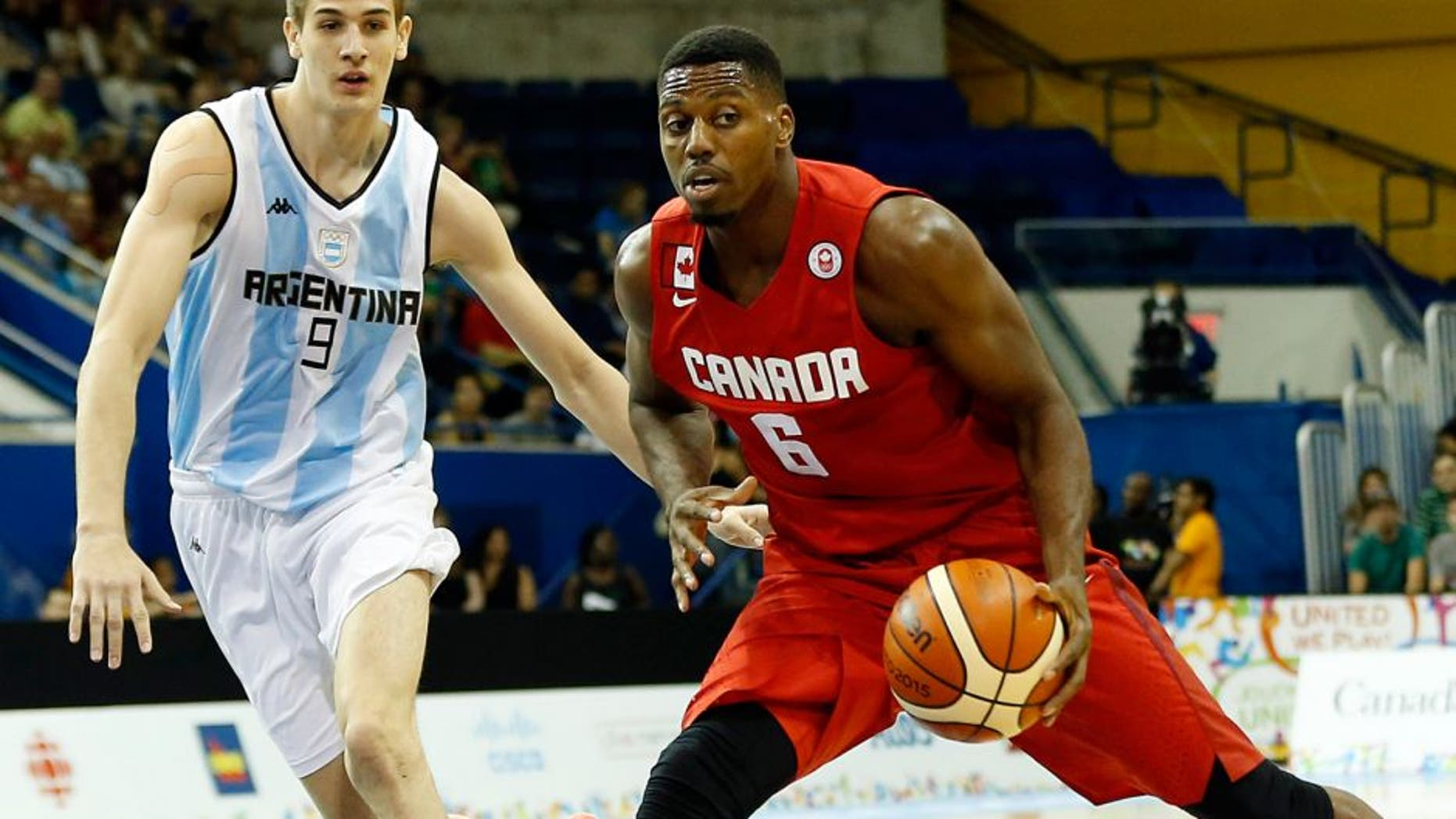 Jul 22, 2015; Toronto, Ontario, CAN; Canada forward Melvin Ejim (6) drives to the basket against Argentina forward Nicolas Brussino (9) in the men's basketball preliminary round during the 2015 Pan Am Games at Ryerson Athletic Centre. Mandatory Credit: Geoff Burke-USA TODAY Sports