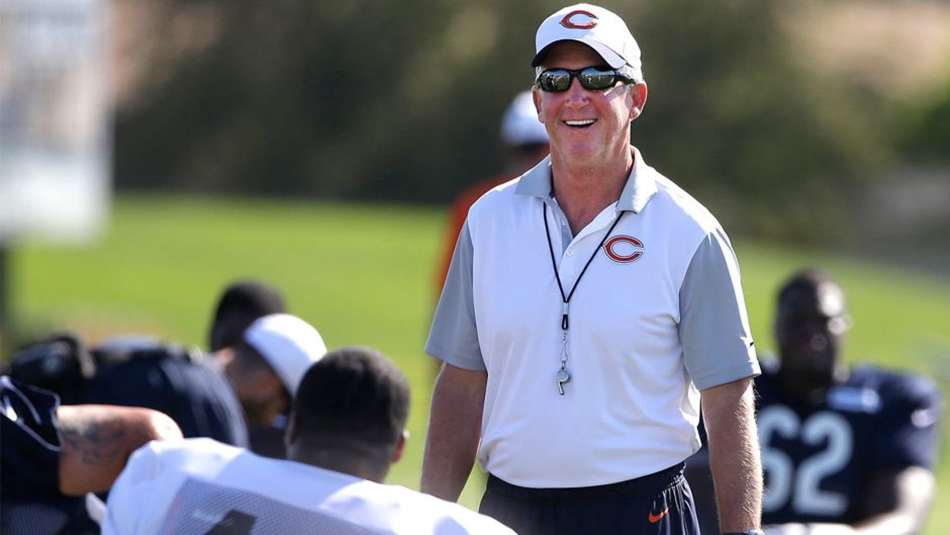 Chicago Bears head coach John Fox smiles as he watches his team during NFL football training camp at Olivet Nazarene University, Saturday, Aug. 1, 2015, in Bourbonnais, Ill. (AP Photo/Nam Y. Huh)
