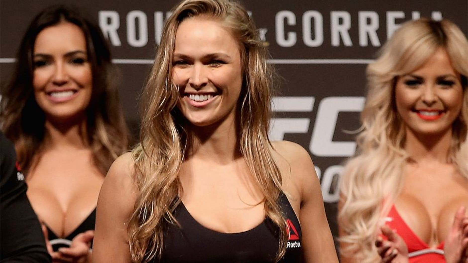 RIO DE JANEIRO, BRAZIL - JULY 31: UFC Strawweight Champion Ronda Rousey of the United States steps onto the scale during the UFC 190 Rousey v Correia weigh-in at HSBC Arena on July 31, 2015 in Rio de Janeiro, Brazil. (Photo by Matthew Stockman/Getty Images)