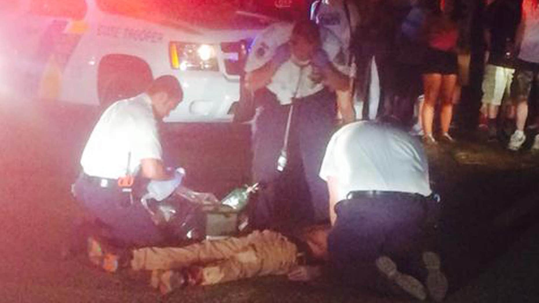 Aug . 3, 2015: Authorities attend to people following a shooting in Holmdel, N.J.
