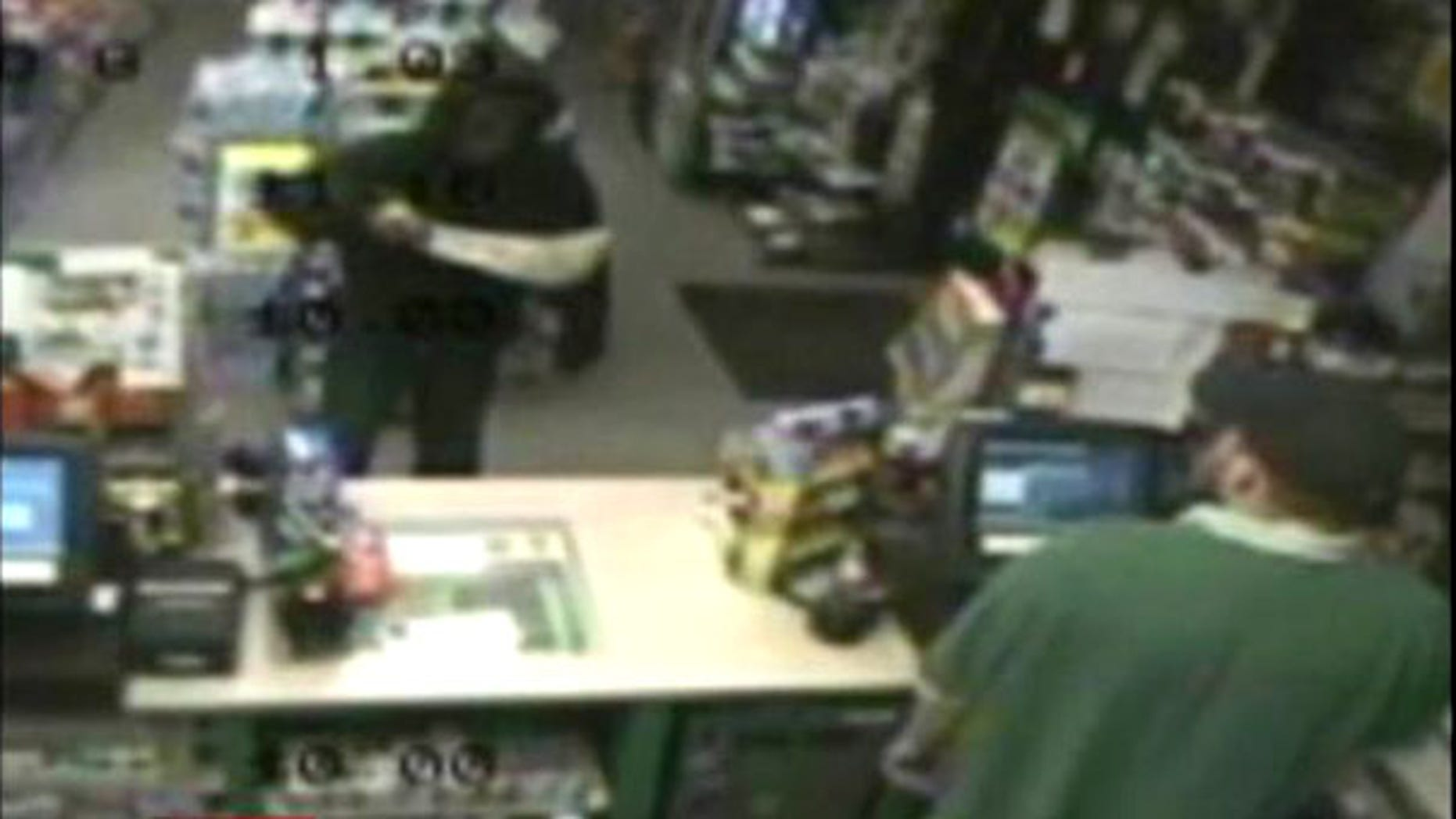 Aug. 3: An unidentified man wielding a machete is seen robbing a gas station in Raynham, Mass. Police suspect the thief also robbed a pizza delivery man with the massive blade.
