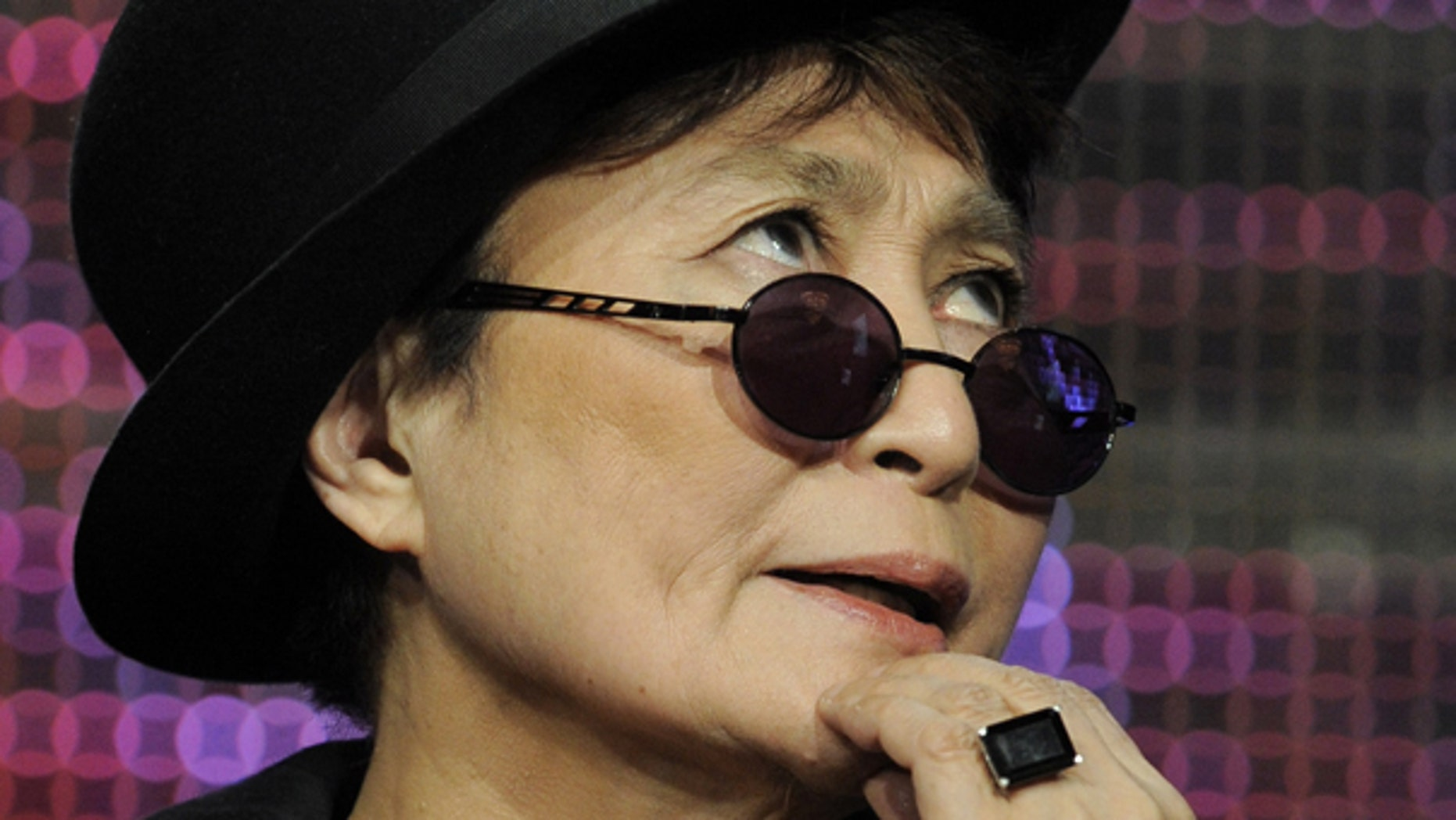 "Aug. 5: Yoko Ono ponders a question during a panel discussion on the PBS special ""Lennon NYC"" at the PBS Television Critics Association summer press tour in Beverly Hills, Calif."