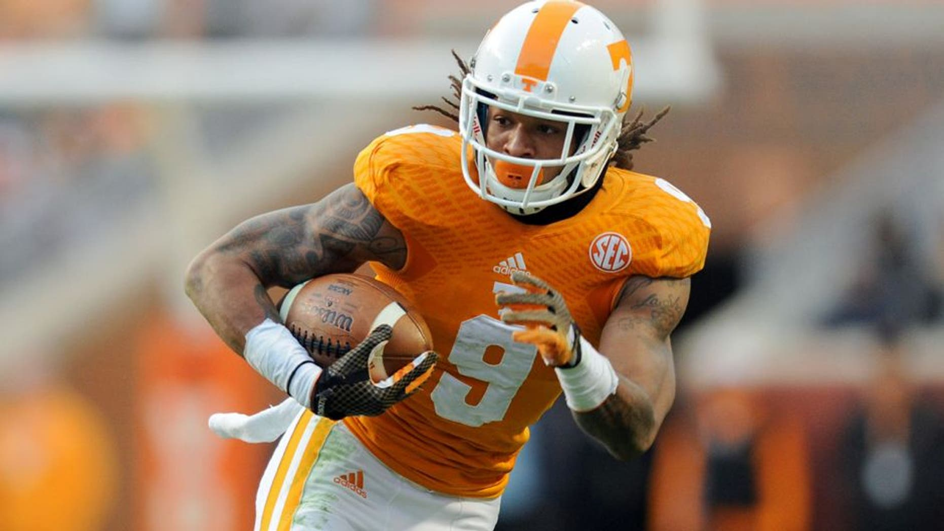 Nov 15, 2014; Knoxville, TN, USA; Tennessee Volunteers wide receiver Von Pearson (9) runs the ball against the Kentucky Wildcats during the first half at Neyland Stadium. Mandatory Credit: Randy Sartin-USA TODAY Sports