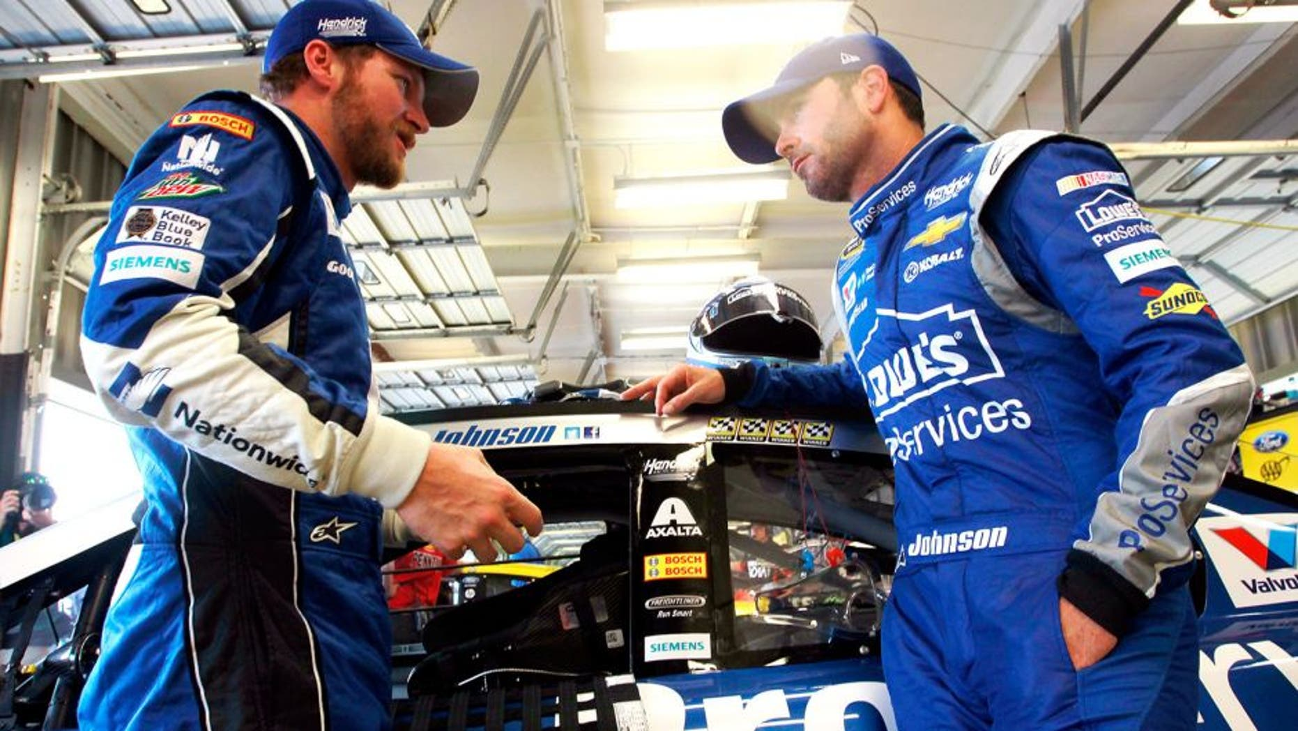 SPARTA, KY - JULY 10: Dale Earnhardt Jr., left, driver of the #88 Nationwide Chevrolet, and Jimmie Johnson, driver of the #48 Lowe's Pro Services Chevrolet, talk in the garage area during practice for the NASCAR Sprint Cup Series Quaker State 400 Presented by Advance Auto Parts at Kentucky Speedway on July 10, 2015 in Sparta, Kentucky. (Photo by Brian Lawdermilk/NASCAR via Getty Images)
