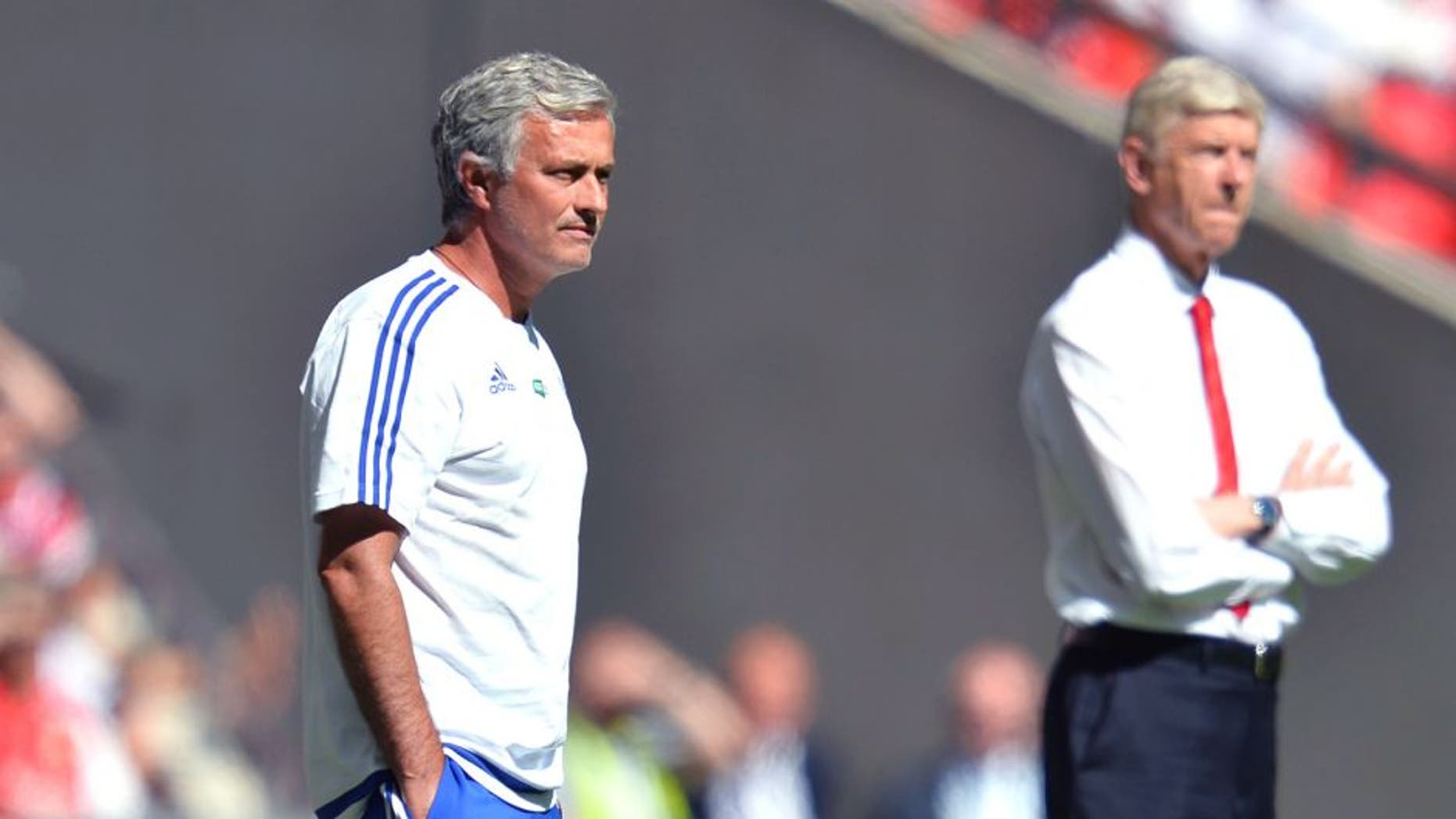 Chelsea's Portuguese manager Jose Mourinho (L) and Arsenal's French manager Arsene Wenger (R) watch from the side during the FA Community Shield football match between Arsenal and Chelsea at Wembley Stadium in north London on August 2, 2015. AFP PHOTO / GLYN KIRK -- NOT FOR MARKETING OR ADVERTISING USE / RESTRICTED TO EDITORIAL USE -- (Photo credit should read GLYN KIRK/AFP/Getty Images)