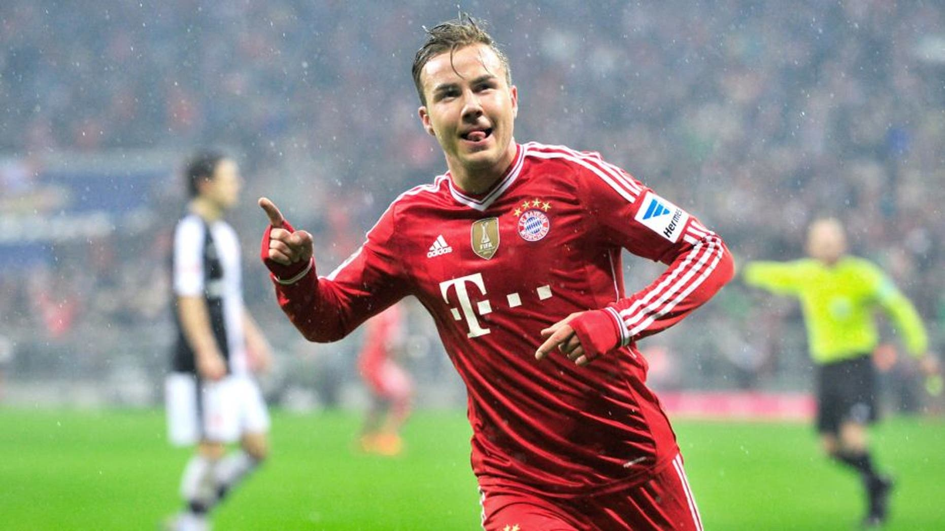 MUNICH, GERMANY - FEBRUARY 02: Mario Goetze of Muenchen celebrates his opening goal during the Bundesliga match between FC Bayern Muenchen and Eintracht Frankfurt at Allianz Arena on February 2, 2014 in Munich, Germany. (Photo by Lennart Preiss/Bongarts/Getty Images)