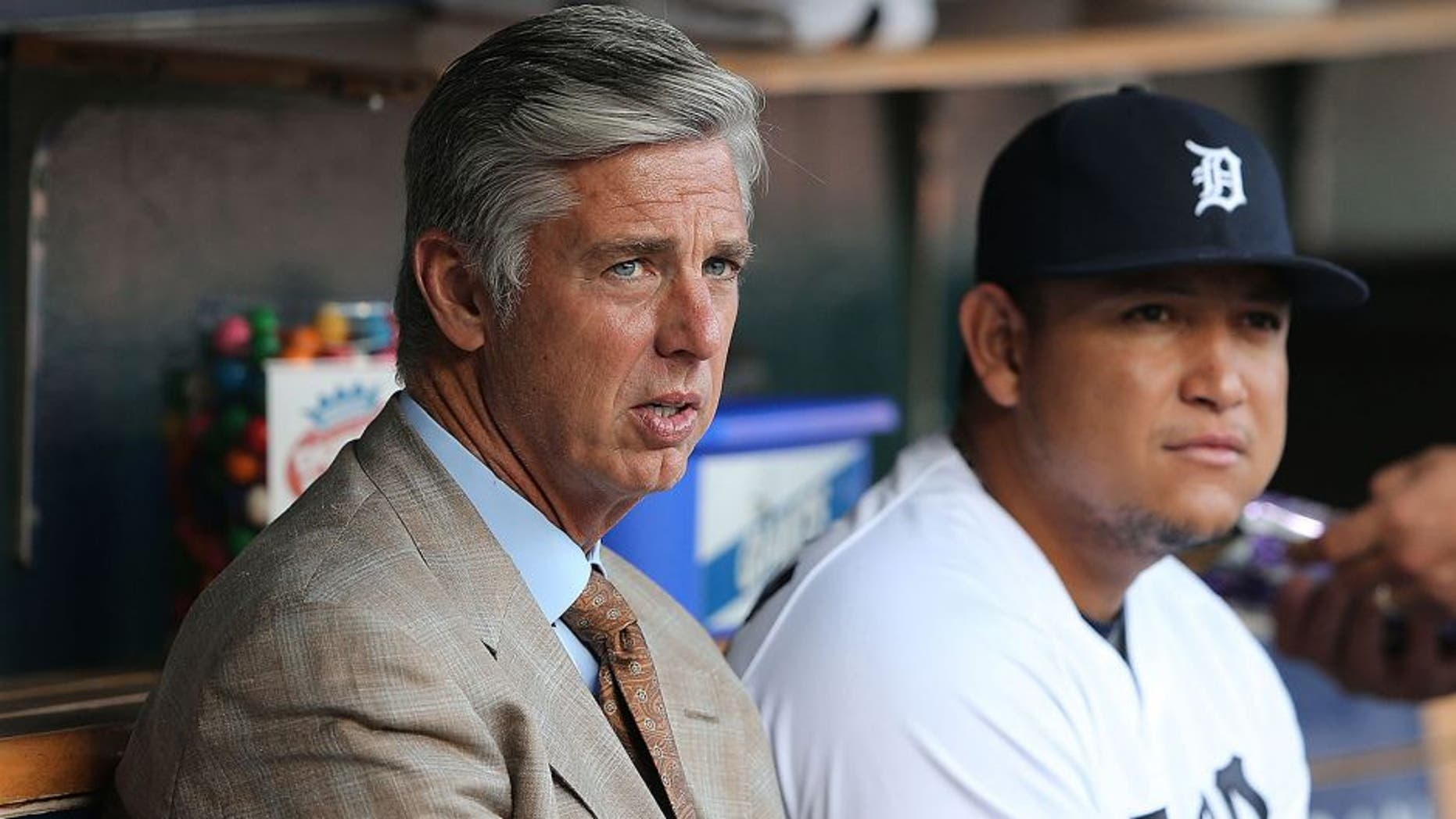DETROIT, MI - AUGUST 02: Detroit Tigers President and General Manager Dave Dombrowski sits next to Miguel Cabrera #24 prior to the start of the game against the Colorado Rockies at Comerica Park on August 2, 2014 in Detroit, Michigan. The Tigers defeated the Rockies 11-4. (Photo by Leon Halip/Getty Images) *** Local Caption *** Dave Dombrowski; Miguel Cabrera