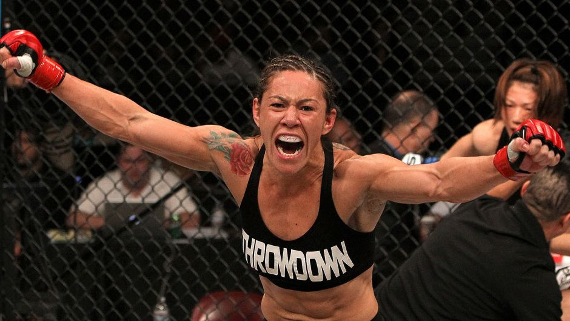 """SAN DIEGO - DECEMBER 17: Cris """"Cyborg"""" Santos reacts to her knockout victory over Hiroko Yamanaka during the Strikeforce event at the Valley View Casino Center on December 17, 2011 in San Diego, California. (Photo by Josh Hedges/Forza LLC/Forza LLC via Getty Images)"""