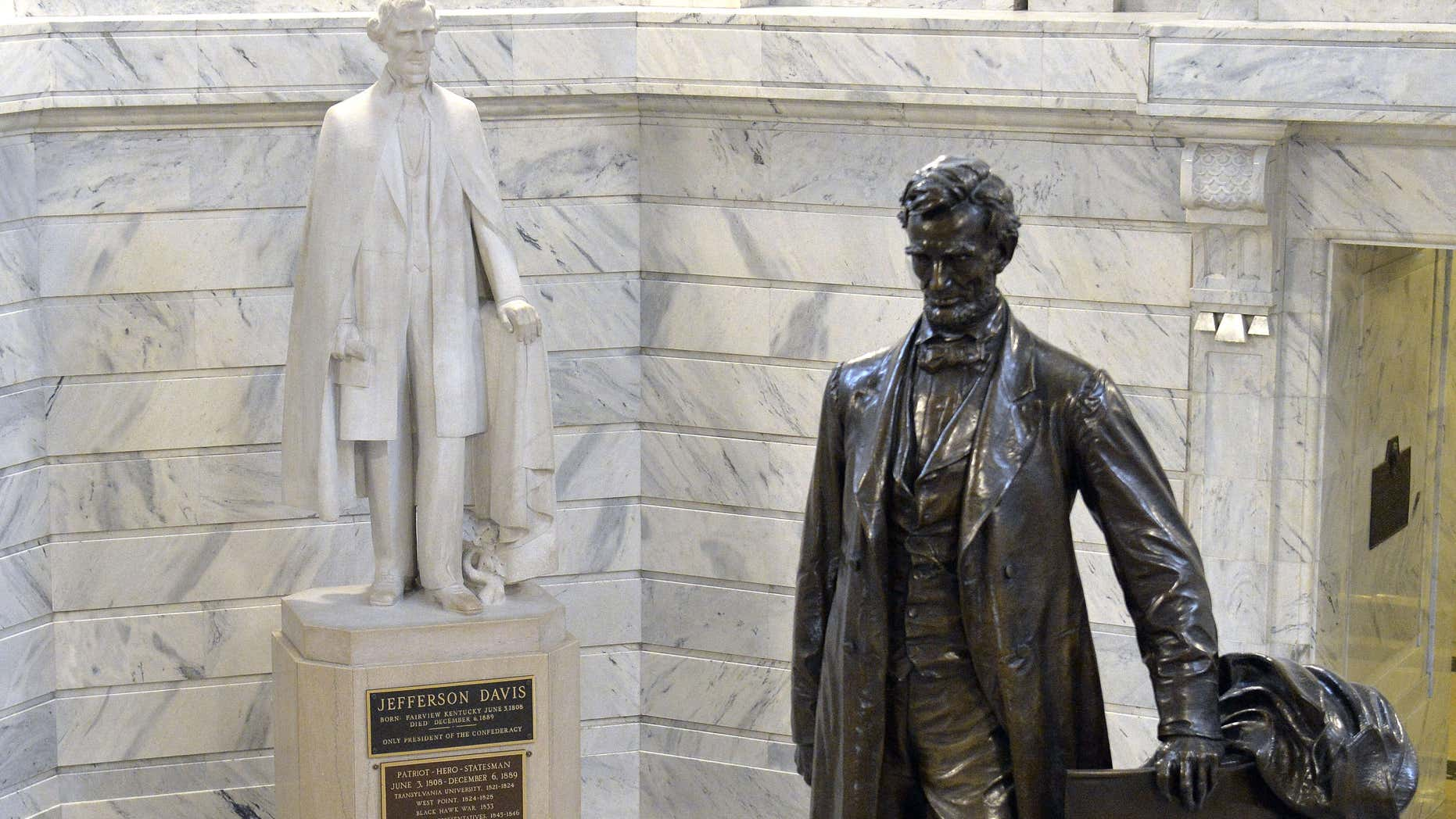 Aug. 5, 2015: The statue of Jefferson Davis, left, overlooks the statue of Abraham Lincoln in the Rotunda of the Kentucky State Capitol in Frankfort Ky.