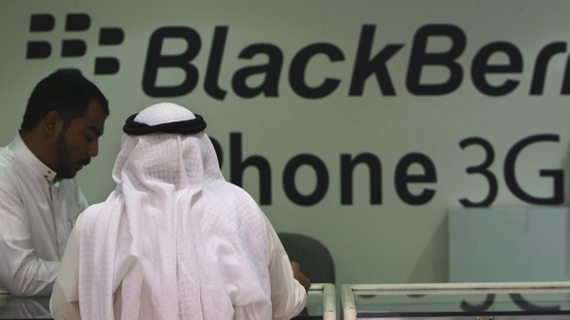 Aug. 5: A Saudi customer is served in a mobile shop at a market in the capital Riyadh, Saudi Arabia. Some Saudis tried to sell their BlackBerrys ahead of an anticipated ban on the smart phone's messenger service