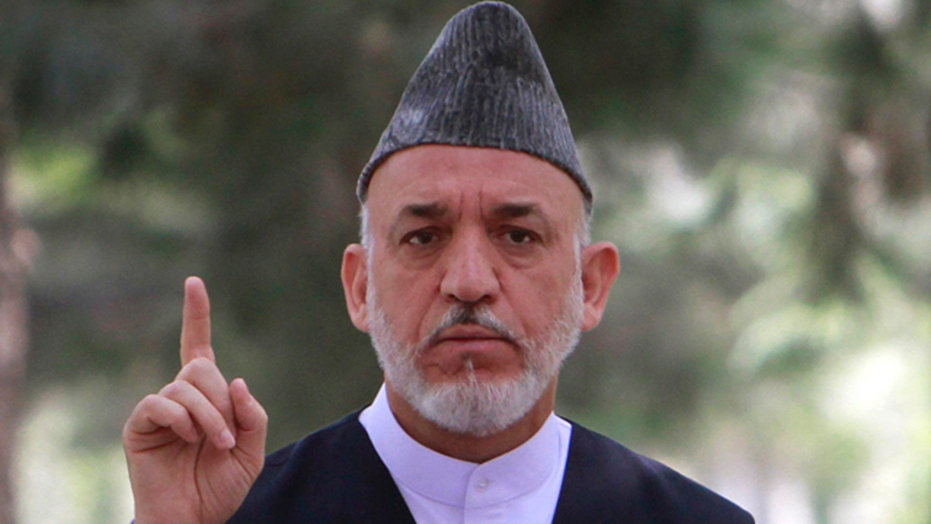 July 26: Afghan President Hamid Karzai speaks during a gathering with high ranking Afghan military officials at the presidential palace in Kabul, Afghanistan.