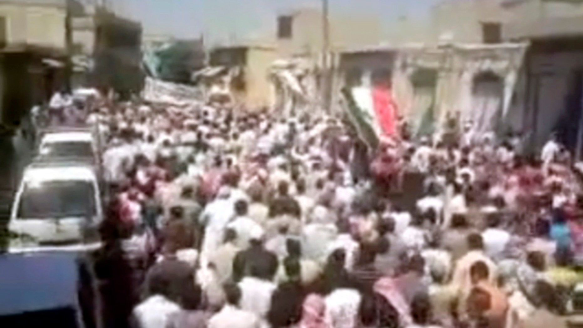 Aug. 5: In this image posted on the Internet by Shaam News Network, showing what they purport to be a demonstration in the streets of the city of Homs, Syria.