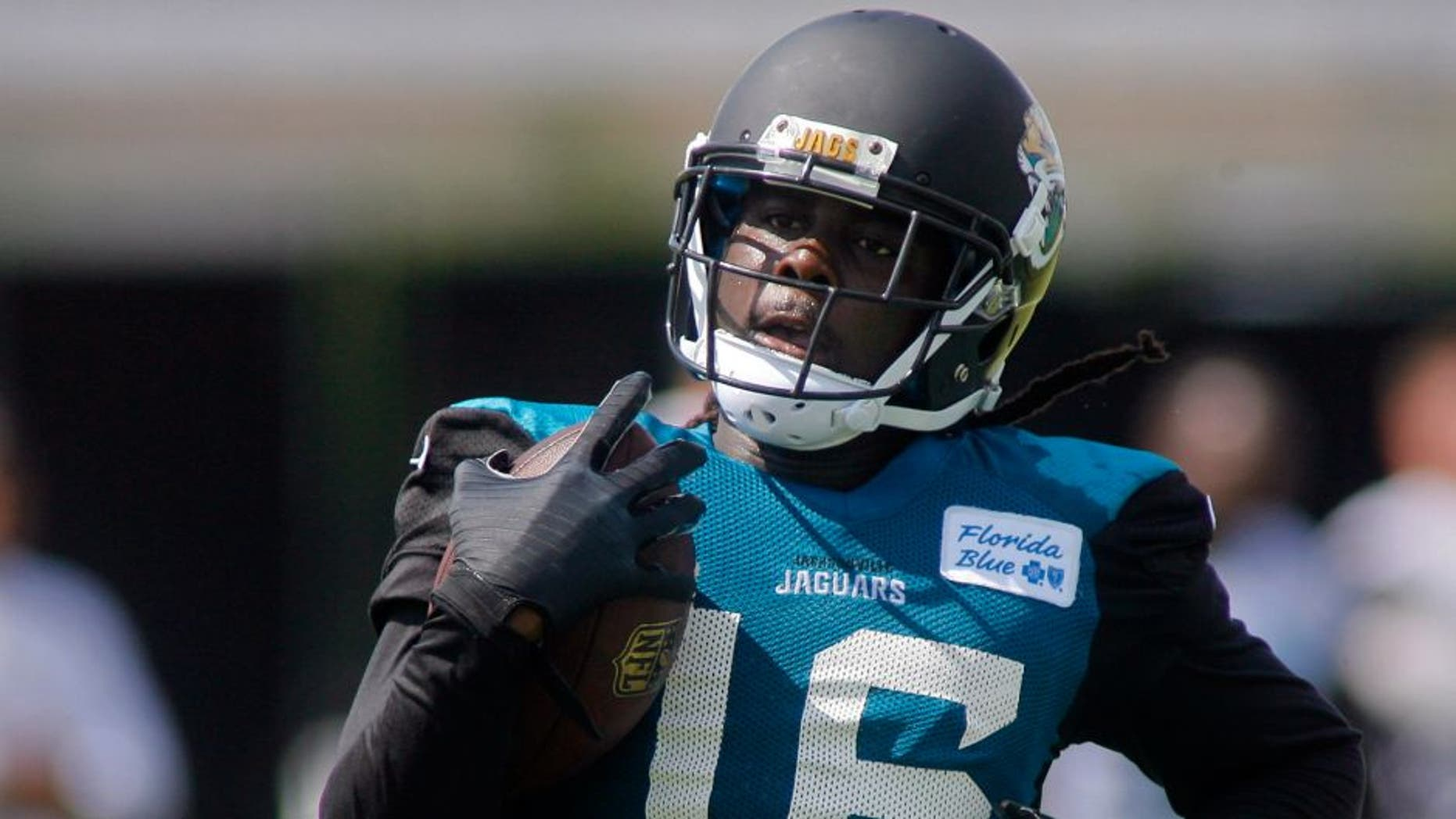 Jul 25, 2014; Jacksonville, FL, USA; Jacksonville Jaguars wide receiver Denard Robinson (16) runs with the ball during the first day of training camp at Florida Blue Health and Wellness Practice Fields. Mandatory Credit: Phil Sears-USA TODAY Sports