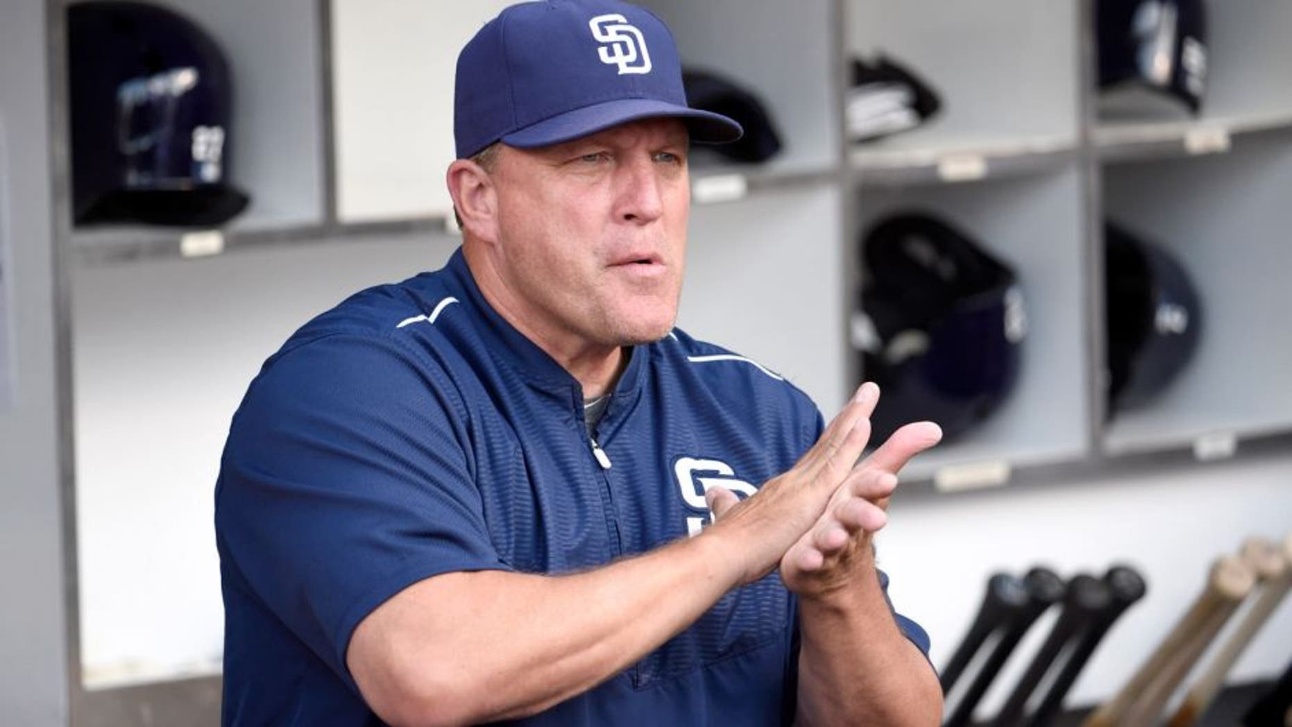 SAN DIEGO, CA - JULY 17: Interim manager Pat Murphy #24 of the San Diego Padres looks out from the dugout before a baseball game against the Colorado Rockies at Petco Park July 17, 2015 in San Diego, California. (Photo by Denis Poroy/Getty Images)