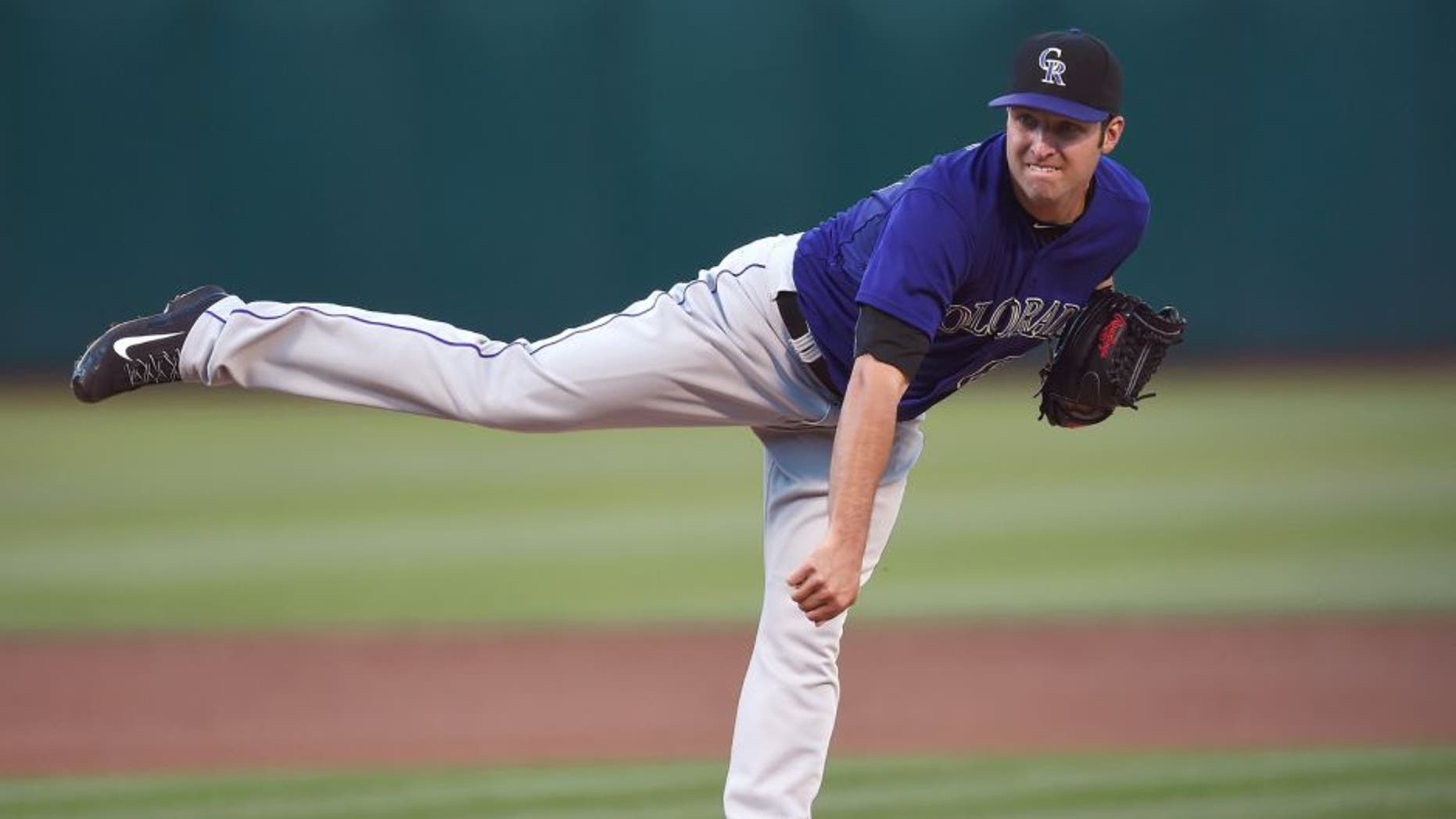 OAKLAND, CA - JUNE 29: David Hale #61 of the Colorado Rockies pitches against the Oakland Athletics in the bottom of the first inning at O.co Coliseum on June 29, 2015 in Oakland, California. (Photo by Thearon W. Henderson/Getty Images)