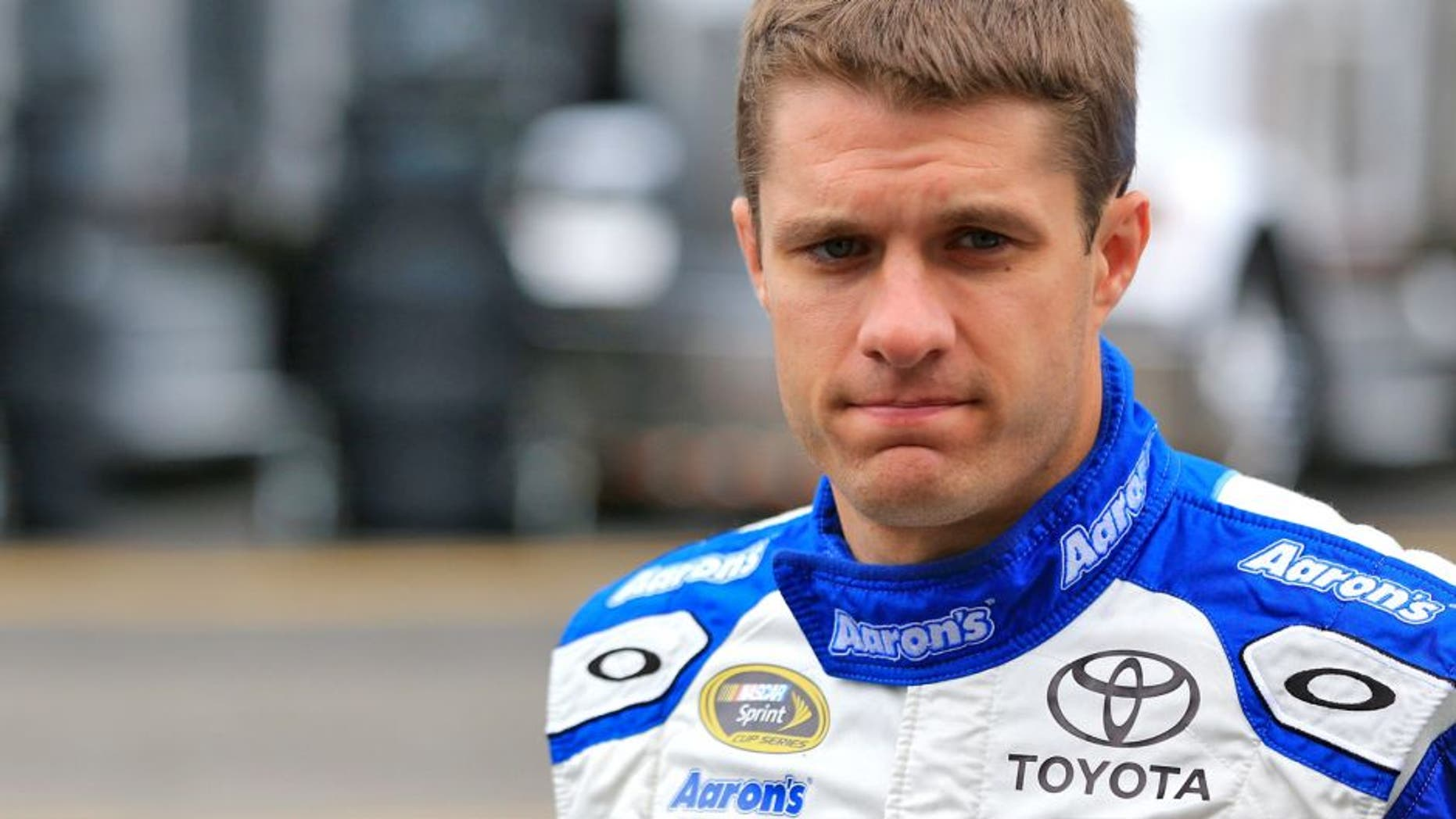 SPARTA, KY - JULY 10: David Ragan, driver of the #55 Aaron's Dream Machine Toyota, walks through the garage area during practice for the NASCAR Sprint Cup Series Quaker State 400 Presented by Advance Auto Parts at Kentucky Speedway on July 10, 2015 in Sparta, Kentucky. (Photo by Daniel Shirey/Getty Images)