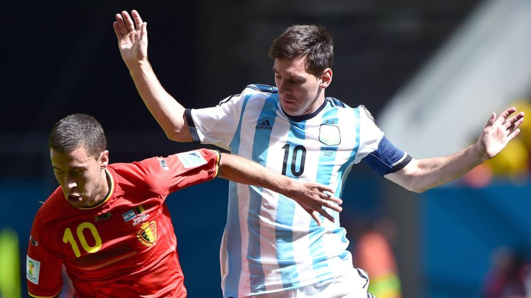 Belgium's midfielder Eden Hazard (L) vies with Argentina's forward Lionel Messi during the second half of a quarter-final football match between Argentina and Belgium at the Mane Garrincha National Stadium in Brasilia during the 2014 FIFA World Cup on July 5, 2014. AFP PHOTO / FRANCOIS XAVIER MARIT (Photo credit should read FRANCOIS XAVIER MARIT/AFP/Getty Images)