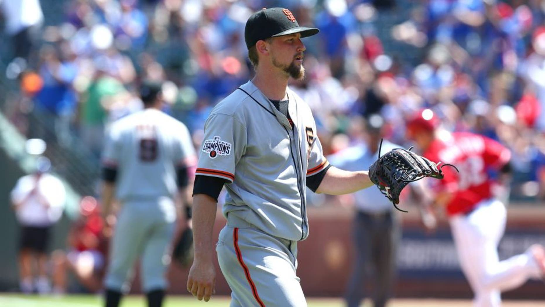 ARLINGTON, TX - AUGUST 02: Mike Leake #13 of the San Francisco Giants steps off the mound after giving up a two-run home run against Josh Hamilton #32 of the Texas Rangers in the sixth inning at Globe Life Park in Arlington on August 2, 2015 in Arlington, Texas. (Photo by Ronald Martinez/Getty Images)