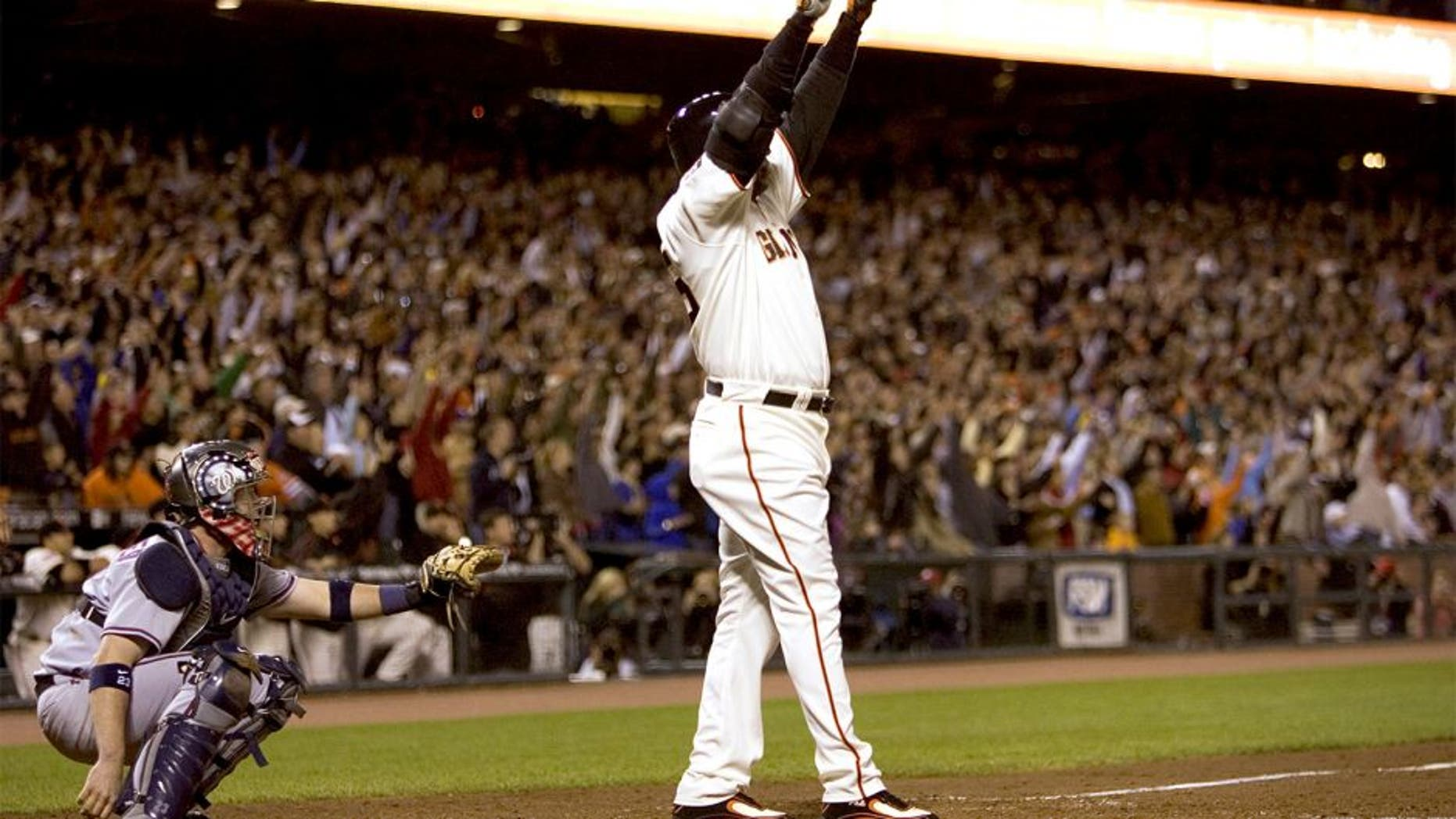 San Francisco Giants' Barry Bonds celebrates home run number 756 to break Hank Aaron's home run record in the fifth inning against the Washington Nationals at AT&T Park in San Francisco California, Tuesday, August 7, 2007. (Paul Kitagaki Jr/Sacramento Bee/MCT)