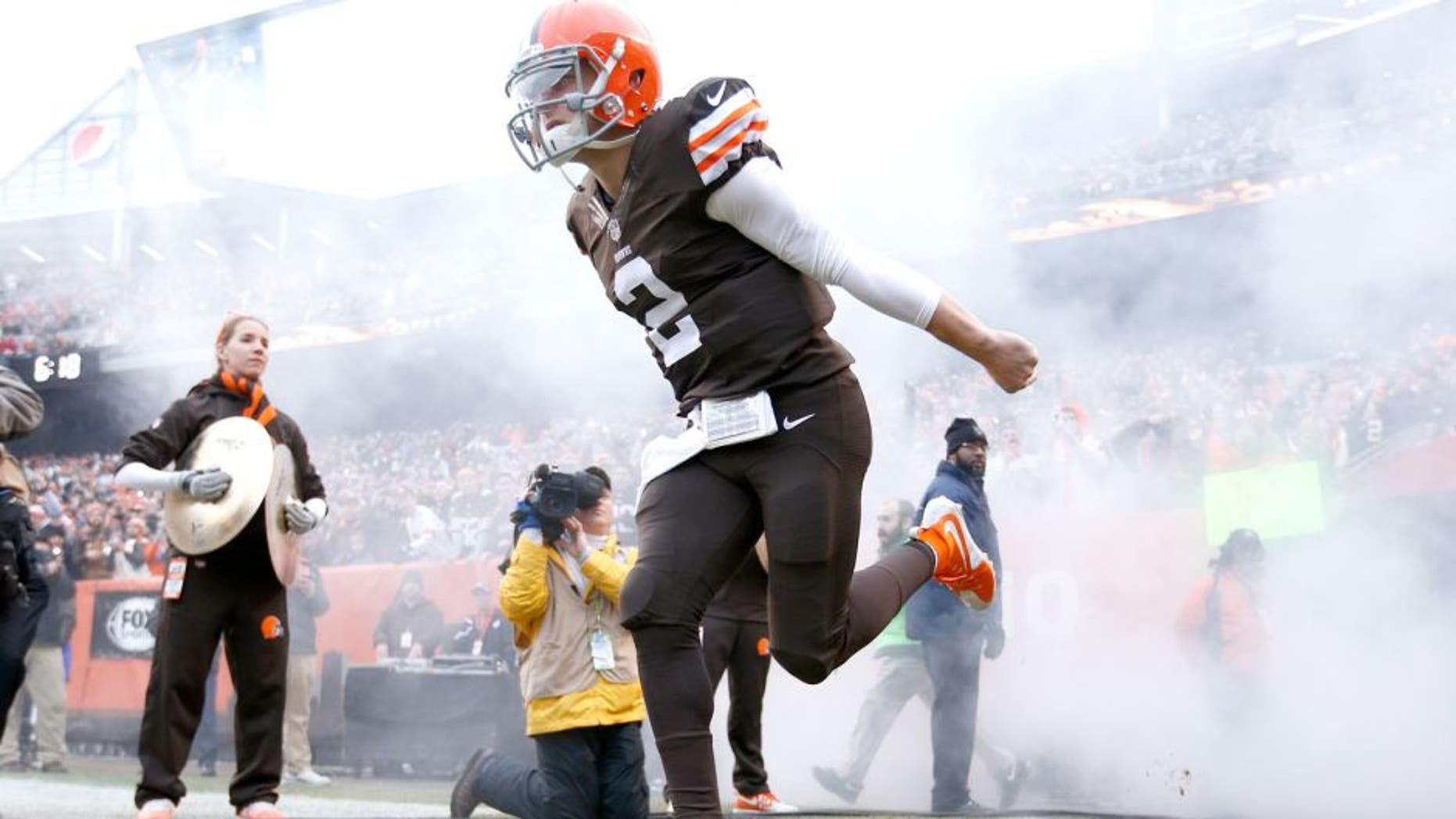 CLEVELAND, OH - DECEMBER 14: Johnny Manziel #2 of the Cleveland Browns runs onto the field during player introductions before the game against the Cincinnati Bengals at FirstEnergy Stadium on December 14, 2014 in Cleveland, Ohio. The Bengals defeated the Browns 30-0. (Photo by Joe Robbins/Getty Images)