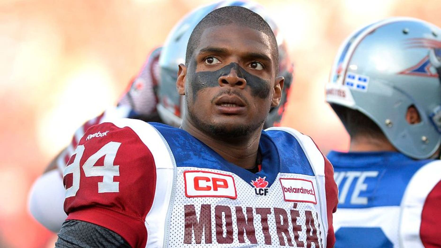 Montreal Alouettes' Michael Sam and teammates warm up for a Canadian Football League game against the Ottawa Redblacks in Ottawa, Ontario, on Friday, Aug. 7, 2015. (Justin Tang/The Canadian Press via AP)