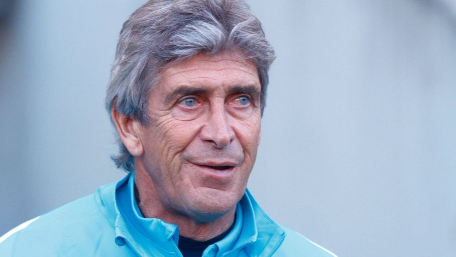 Manchester City coach Manuel Pellegrini watches his team warm up before the friendly football match between English Premier League side Manchester City and A-League side Melbourne City at Cbus Super Stadium on the Gold Coast on July 18, 2015. AFP PHOTO / JOHN PRYKE -- IMAGE RESTRICTED TO EDITORIAL USE - STRICTLY NO COMMERCIAL USE (Photo credit should read JOHN PRYKE/AFP/Getty Images)