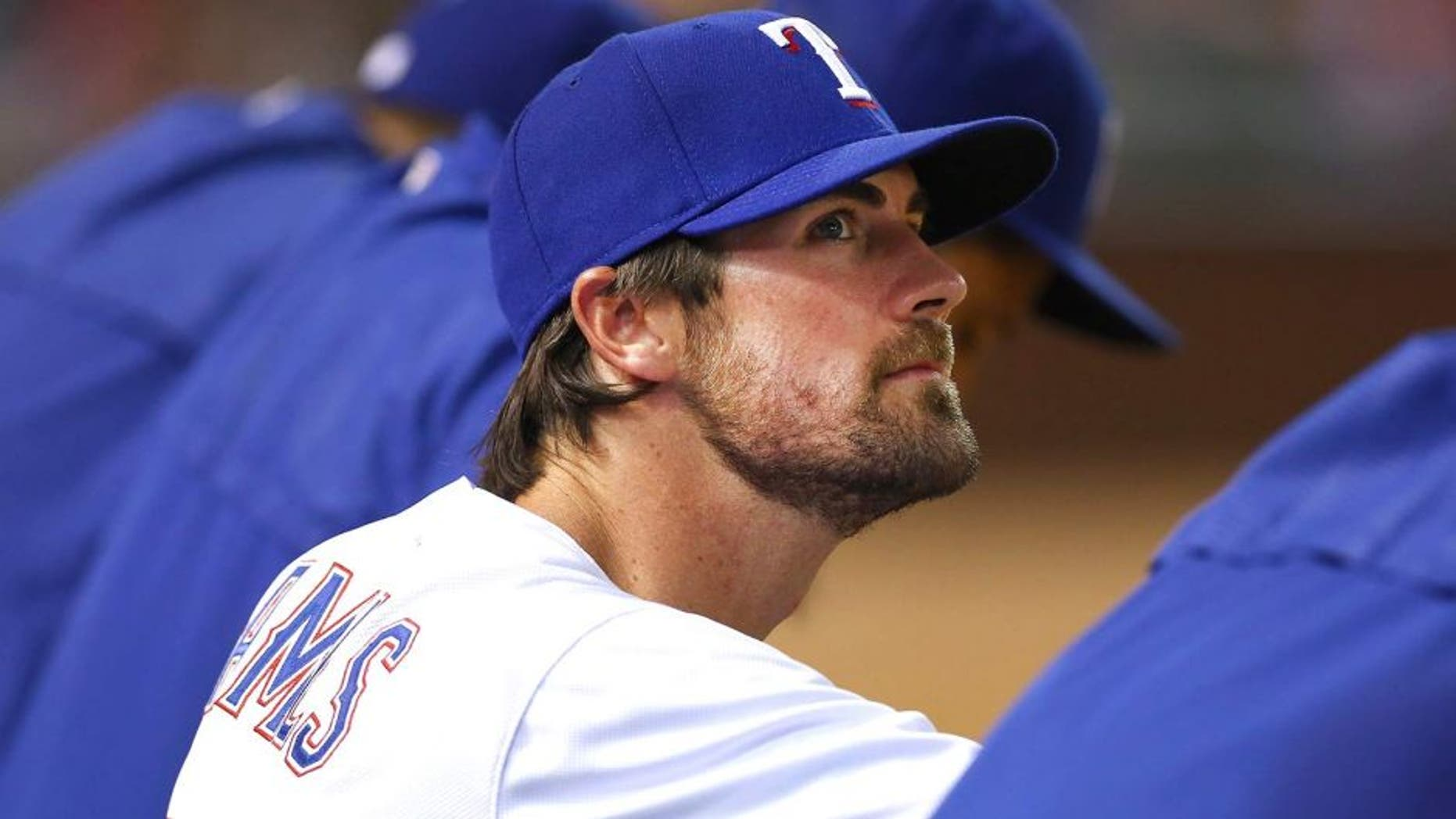 ARLINGTON, TX - JULY 31: Cole Hamels #35 of the Texas Rangers looks on as the Rangers take on the San Francisco Giants in the bottom of the eighth inning at Globe Life Park in Arlington on July 31, 2015 in Arlington, Texas. (Photo by Tom Pennington/Getty Images)