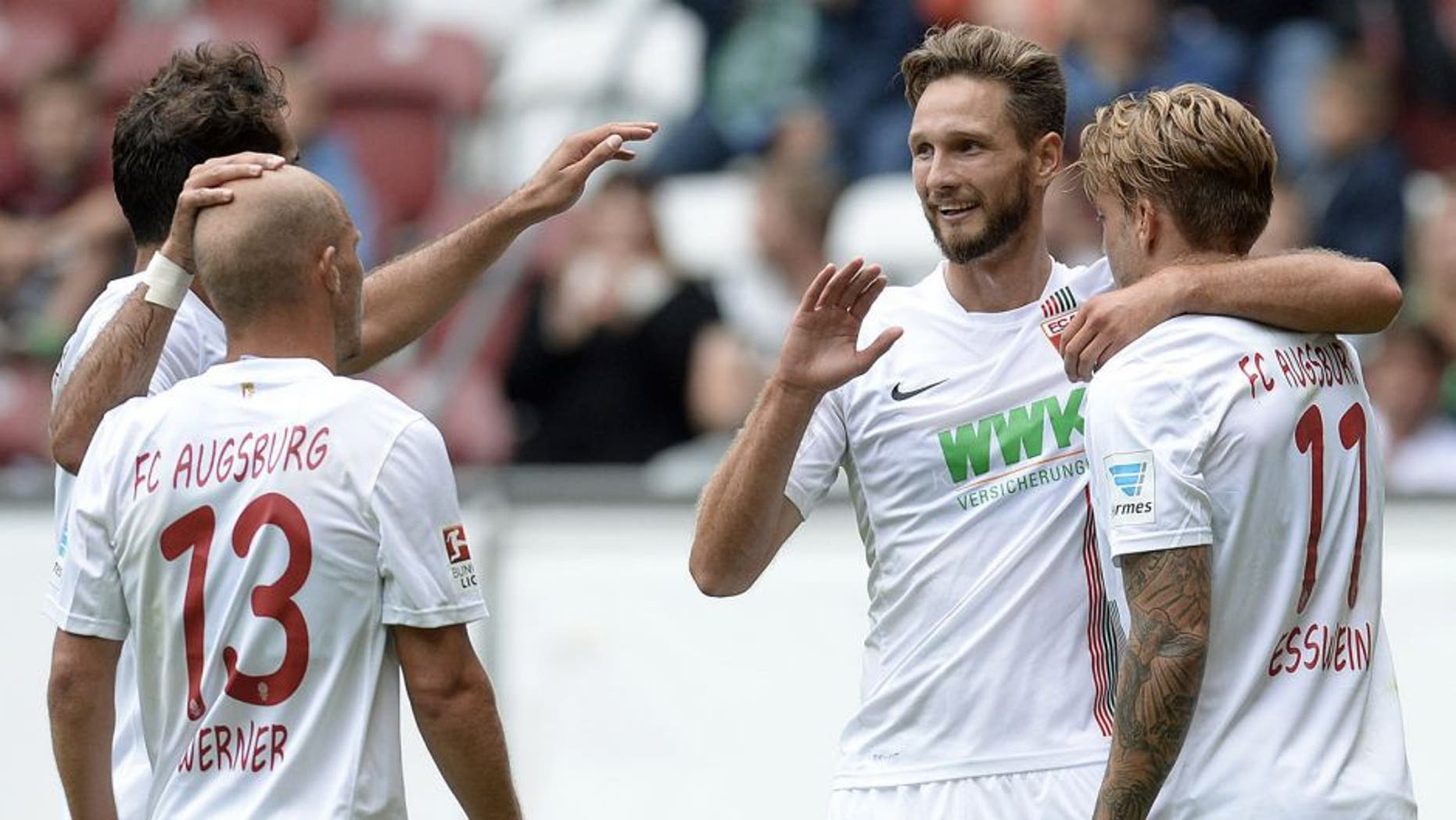 (L-R) Augsburg's Turkish midfielder Halil Altintop, Augsburg's midfielder Tobias Werner, Augsburg's Serbian striker Tim Matavz and Augsburg's midfielder Alexander Esswein celebrate after the second goal during a friendly football match between German first division Bundesliga team FC Augsburg and French first league football team FC Toulouse in Augsburg, southern Germany, on August 1, 2015. AFP PHOTO / CHRISTOF STACHE (Photo credit should read CHRISTOF STACHE/AFP/Getty Images)