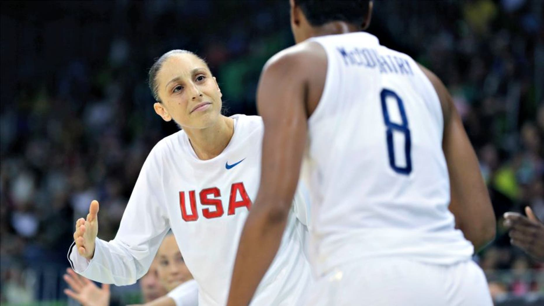 United States guard Diana Taurasi greets teammate Angel McCoughtry after a play during the second half of a women's basketball game against Senegal at the Youth Center at the 2016 Summer Olympics in Rio de Janeiro, Brazil, Sunday, Aug. 7, 2016. The United States defeated Senegal 121-56. (AP Photo/Carlos Osorio)