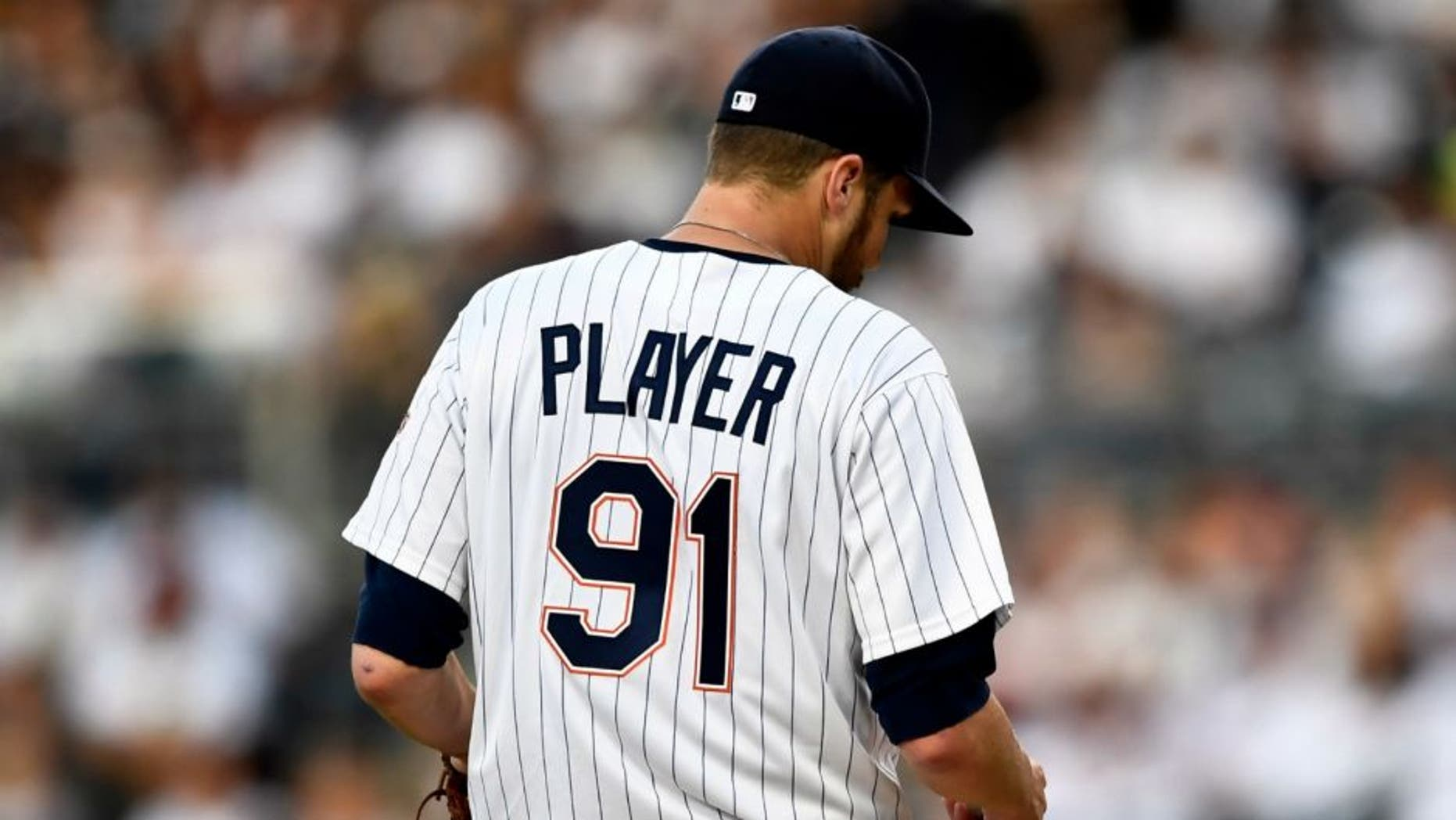 San Diego Padres starting pitcher Paul Clemens stands on the mound during a crucial situation against the Philadelphia Phillies in the fourth inning of a baseball game Saturday, Aug. 6, 2016, in San Diego. Clemens was told to change his jersey by umpire Mike Everett when pine tar was found on the jersey. (AP Photo/San Diego Padres)