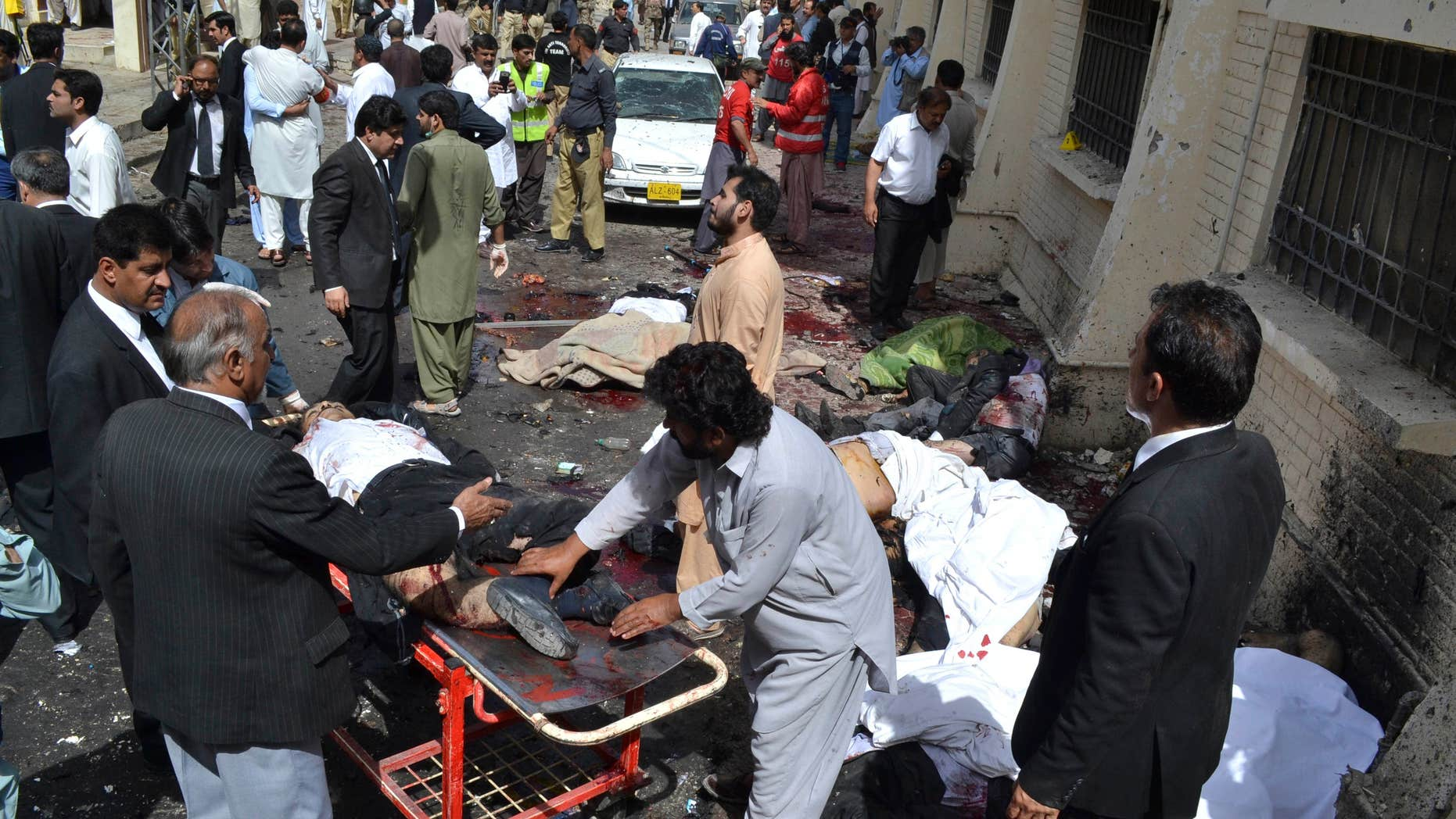 Aug. 8, 2016: People help victims of a bomb blast in Quetta, Pakistan.