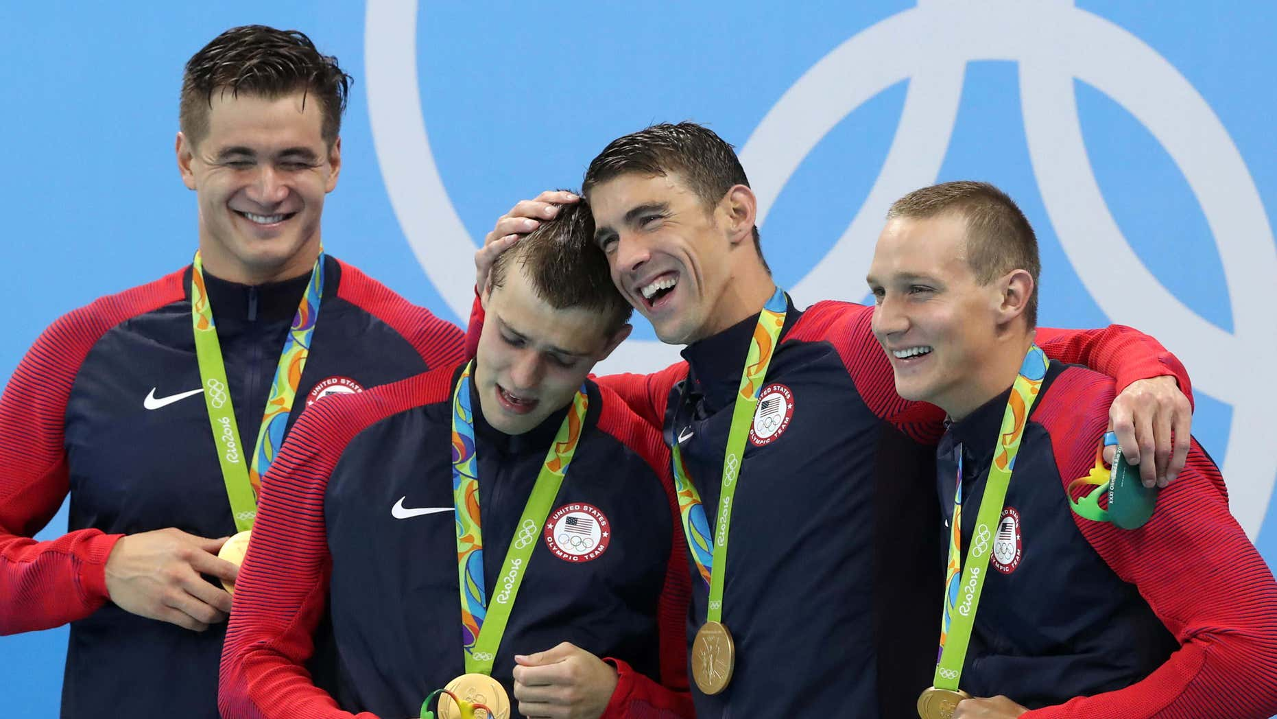 The United States team from left, Nathan Adrian, Ryan Held, Michael Phelps and Caeleb Dressel celebrate on the medal ceremony after winning the gold medal in the men's 4x100-meter freestyle relay during the swimming competitions at the 2016 Summer Olympics, Monday, Aug. 8, 2016, in Rio de Janeiro, Brazil.