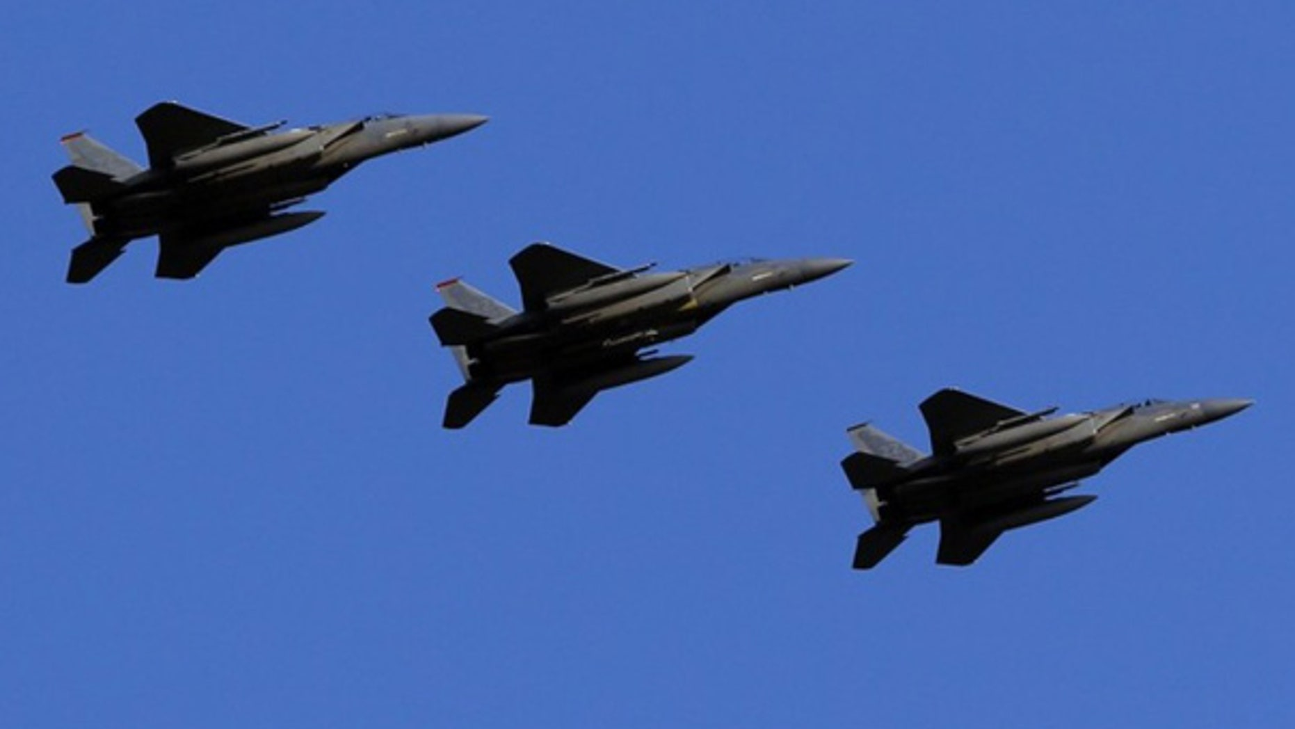Feb. 25: U.S. Air Force F-15 Eagle fighter jets fly over Kadena Air Base in Japan.