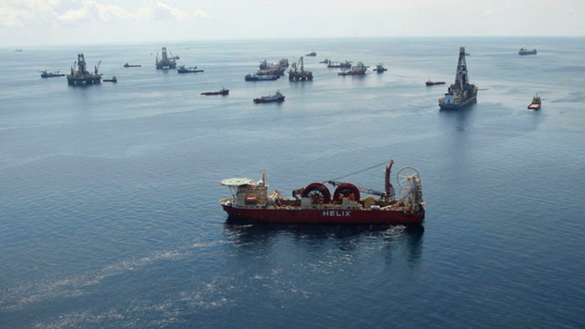 Aug. 3: A support vessel, foreground center, and others surround the Helix Q4000, background center, used to perform the static kill operation, at the site of the Deepwater Horizon Oil Spill in the Gulf of Mexico, off the coast of Louisiana.