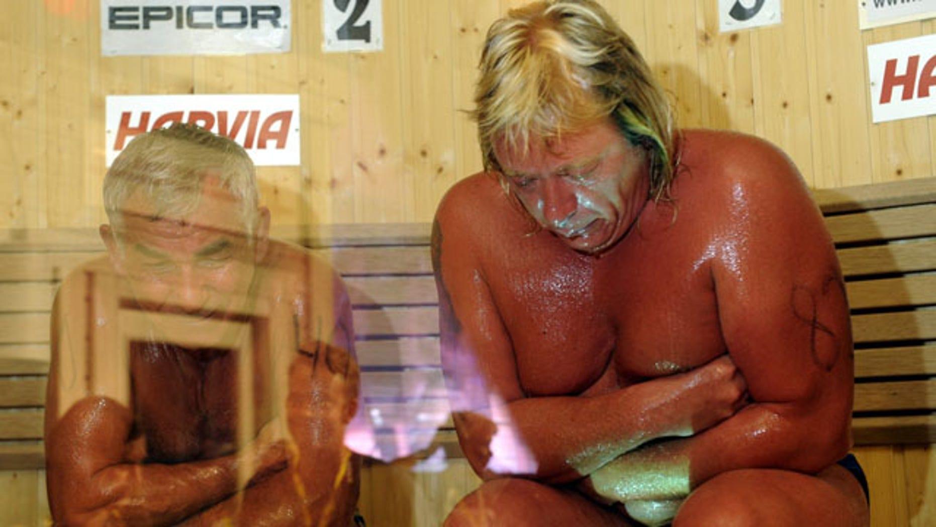 Aug. 7: Russia's Vladimir Ladyzhenskiy, left, and Finland's Timo Kaukonen seen during the World Sauna Championships in Heinola, Finland.