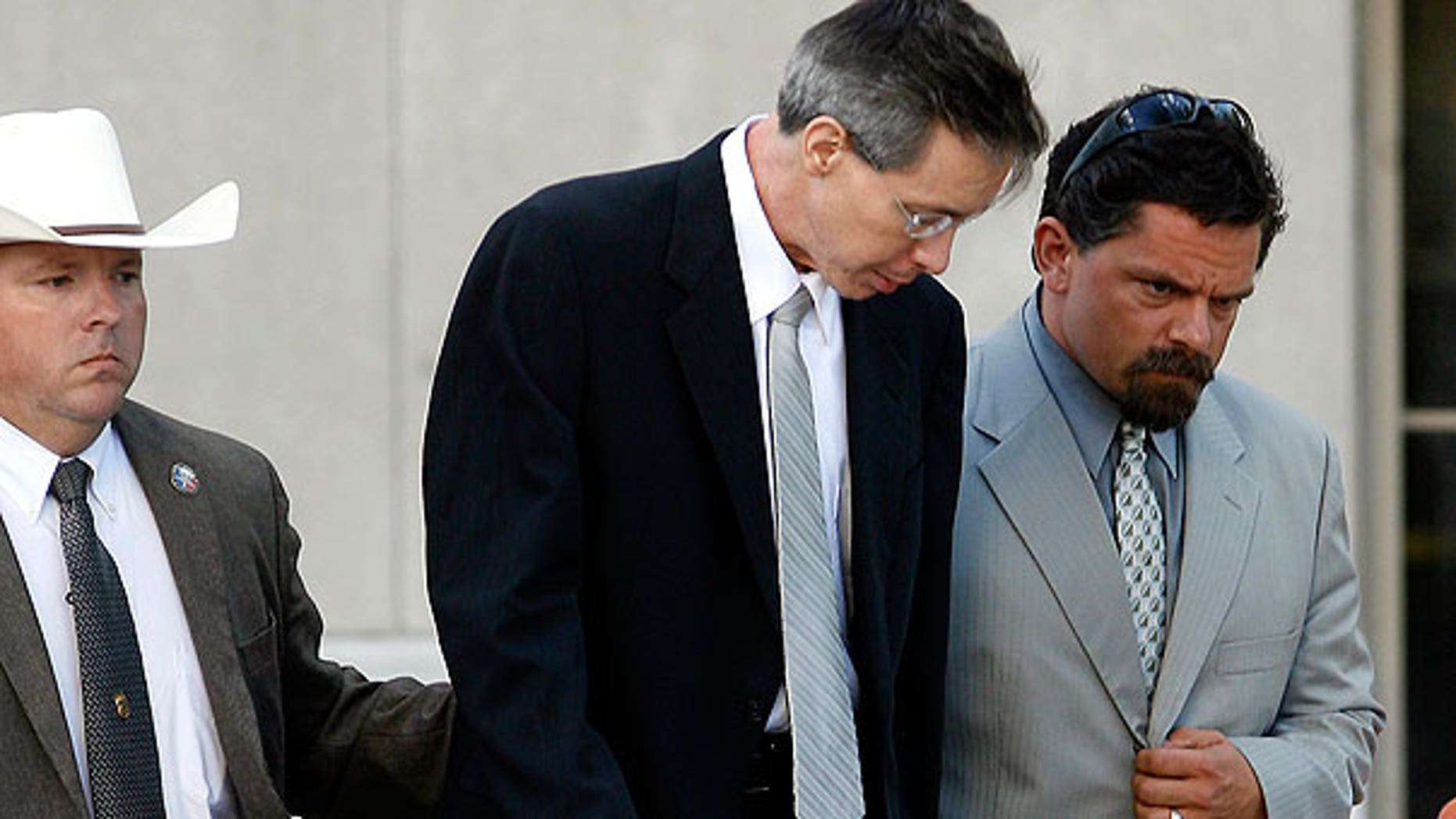 Aug. 4: Polygamist sect leader Warren Jeffs walks out of the Tom Green County Courthouse with his former attorney Deric Walpole in San Angelo, Texas.