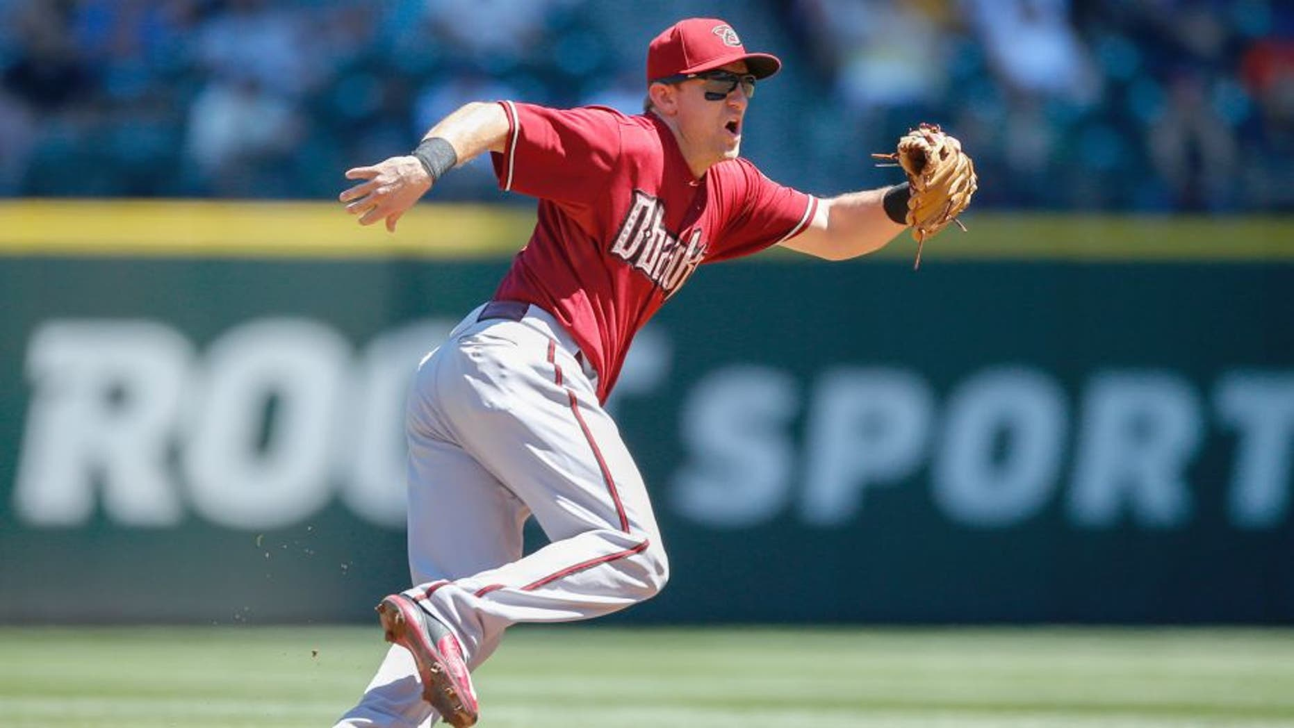 SEATTLE, WA - JULY 29: Shortstop Cliff Pennington #4 of the Arizona Diamondbacks fields a grounder against the Seattle Mariners at Safeco Field on July 29, 2015 in Seattle, Washington. (Photo by Otto Greule Jr/Getty Images)