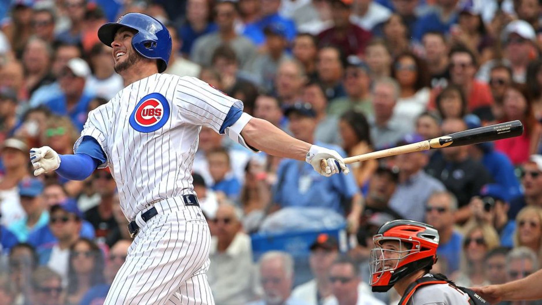 CHICAGO, IL - AUGUST 08: Kris Bryant #17 of the Chicago Cubs hits a two-run home run in the 3rd inning against the San Francisco Giants at Wrigley Field on August 8, 2015 in Chicago, Illinois. (Photo by Jonathan Daniel/Getty Images)