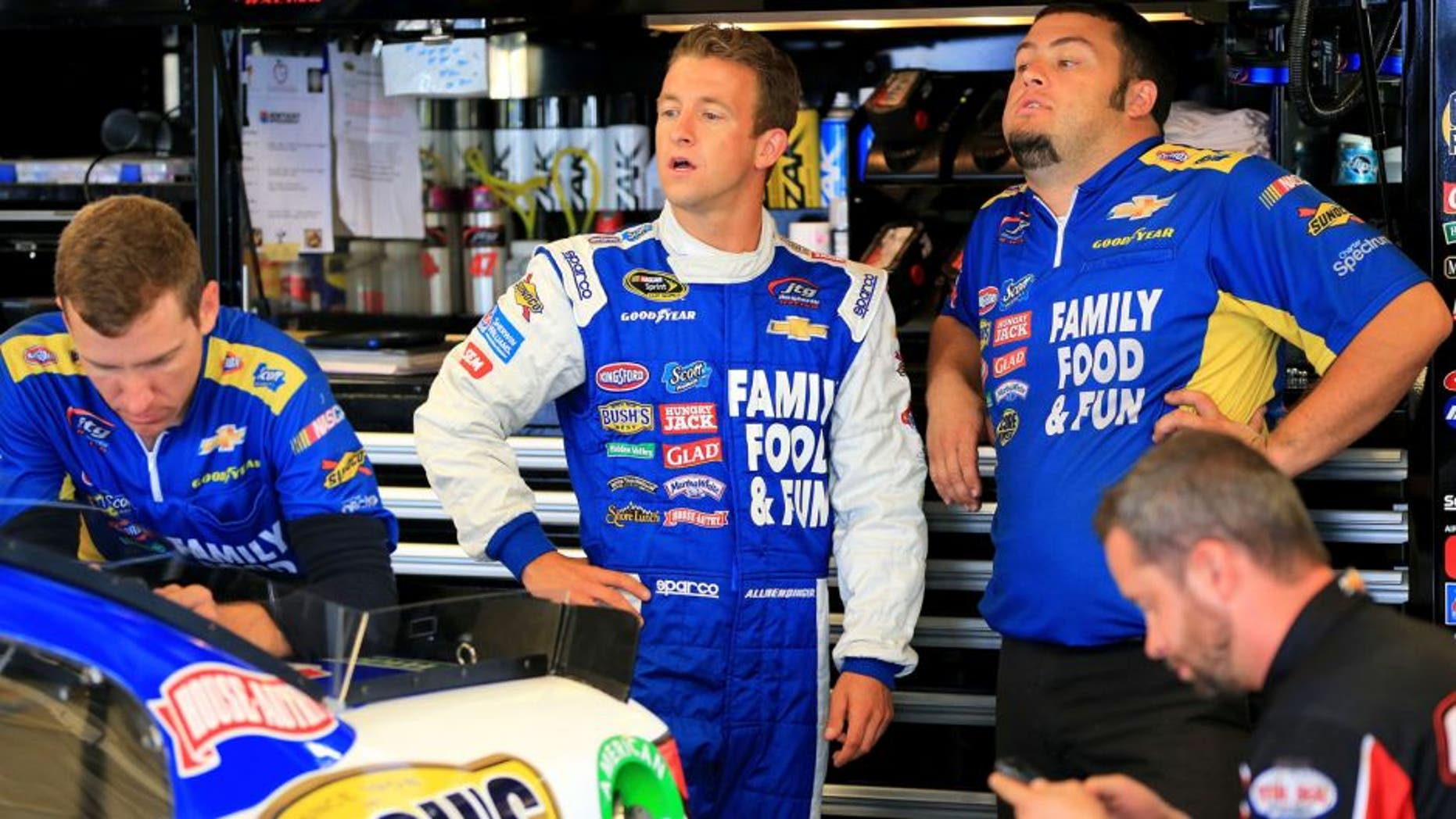 SPARTA, KY - JULY 10: AJ Allmendinger, driver of the #47 Kroger/Scott Products Chevrolet, center, looks on from the garage area during practice for the NASCAR Sprint Cup Series Quaker State 400 Presented by Advance Auto Parts at Kentucky Speedway on July 10, 2015 in Sparta, Kentucky. (Photo by Daniel Shirey/Getty Images)