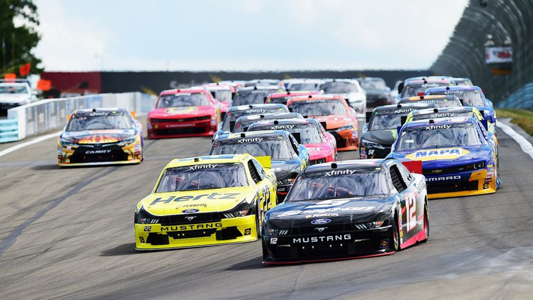 WATKINS GLEN, NY - AUGUST 08: Joey Logano, driver of the #12 Snap-on Ford, and Brad Keselowski, driver of the #22 Hertz Ford, lead a pack of cars during the NASCAR XFINITY Series Zippo 200 at Watkins Glen International on August 8, 2015 in Watkins Glen, New York. (Photo by Jared C. Tilton/NASCAR via Getty Images)