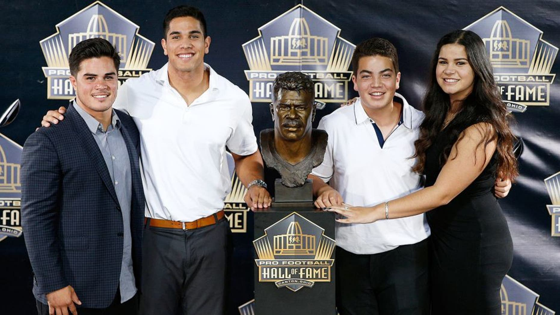 CANTON, OH - AUGUST 8: Junior Seau's children pose with his bust during the NFL Hall of Fame induction ceremony at Tom Benson Hall of Fame Stadium on August 8, 2015 in Canton, Ohio. (Photo by Joe Robbins/Getty Images)