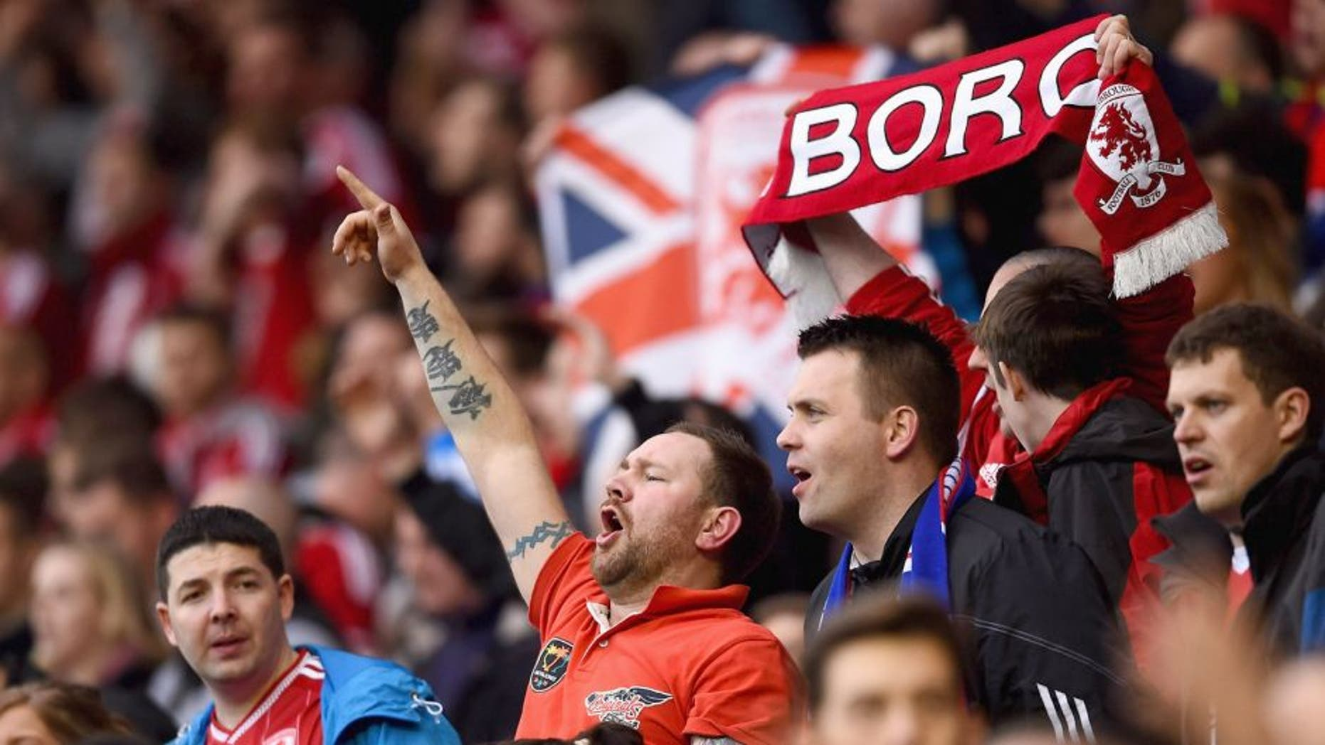 MIDDLESBROUGH, ENGLAND - MAY 15: Middlesbrough fans show their support during the Sky Bet Championship Playoff semi final second leg match between Middlesbrough and Brentford at the Riverside Stadium on May 15, 2015 in Middlesbrough, England. (Photo by Laurence Griffiths/Getty Images)