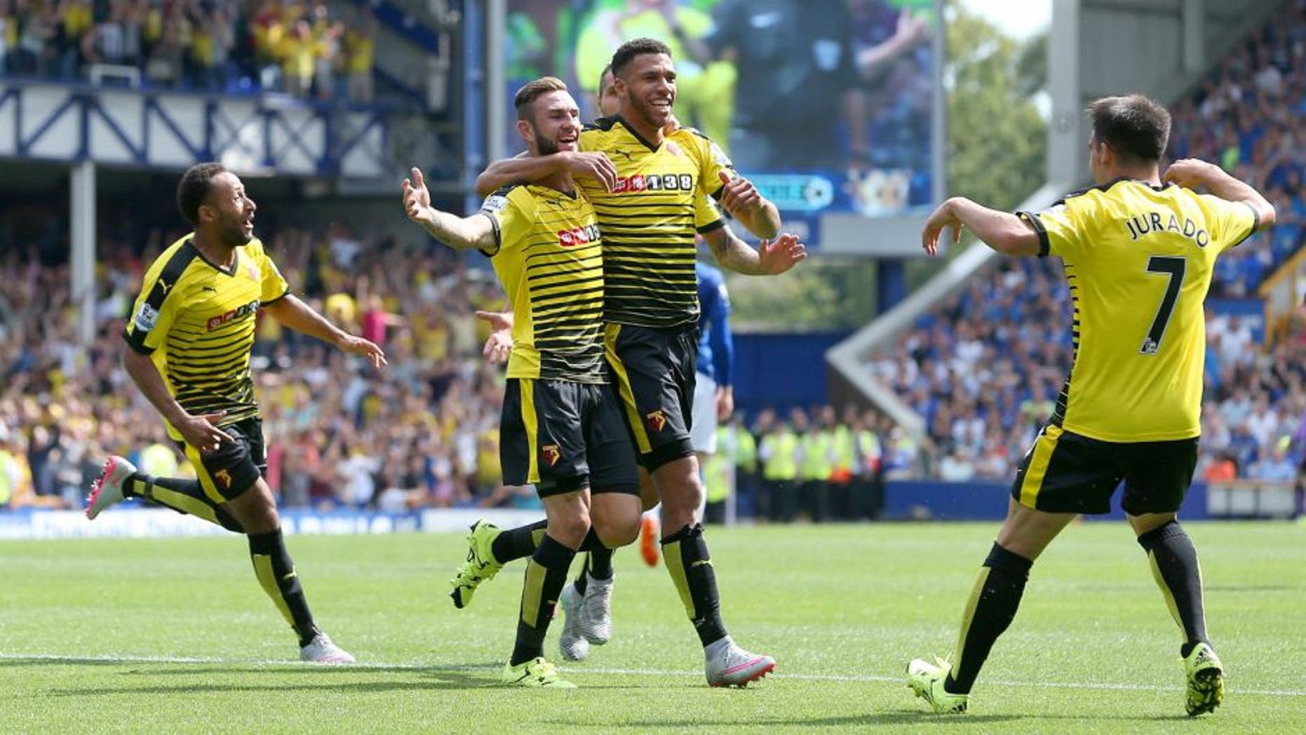 LIVERPOOL, ENGLAND - AUGUST 08: Miguel Layun of Watford celebrates scoring his team's first goal with his team mate Etienne Capoue during the Barclays Premier League match between Everton and Watford at Goodison Park on August 8, 2015 in Liverpool, England. (Photo by Jan Kruger/Getty Images)