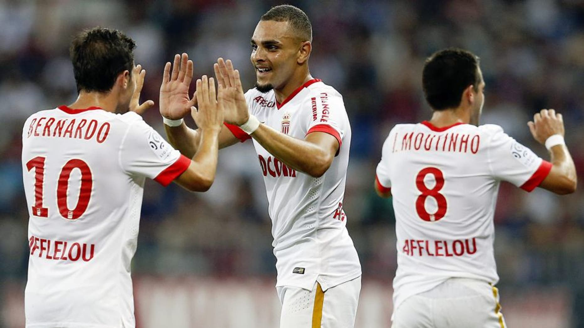 Monaco's French defender Layvin Kurzawa (C) celebrates with Portuguese midfielders Bernardo Silva (L) and Joao Moutinho after scoring his team's second goal during the French L1 football match between Nice and Monaco at the Allianz Riviera stadium in Nice, southeastern France, on August 8, 2015. AFP PHOTO / VALERY HACHE (Photo credit should read VALERY HACHE/AFP/Getty Images)