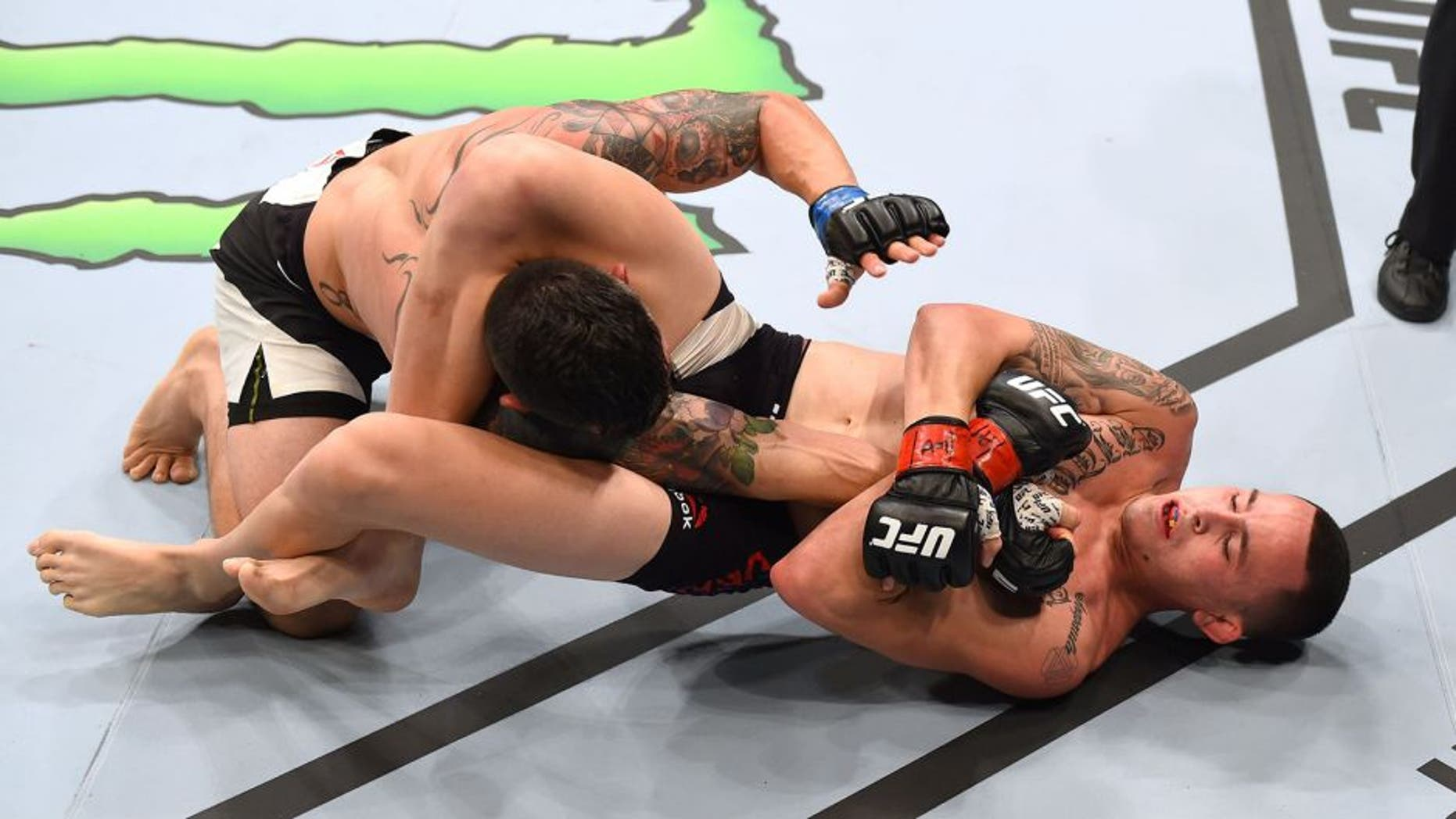 NASHVILLE, TN - AUGUST 08: (R-L) Marlon Vera of Ecuador attempts a submission against Roman Salazar in their bantamweight bout during the UFC Fight Night event at Bridgestone Arena on August 8, 2015 in Nashville, Tennessee. (Photo by Josh Hedges/Zuffa LLC/Zuffa LLC via Getty Images)