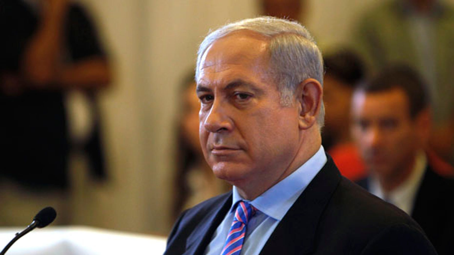 Israel's Prime Minister Benjamin Netanyahu sits before testifying in front of  a state-appointed inquiry commission into the Israeli naval raid on a Gaza aid flotilla, in Jerusalem, Monday, Aug. 9, 2010. Netanyahu testified Monday before his country's inquiry commission into the bloodshed aboard a Turkish ship that tried to break the Gaza blockade in May 2010, defending Israel's actions and suggesting Turkey had been seeking a confrontation. (AP Photo/Ronen Zvulun, Pool)